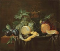 Fruit, a pewter dish and a roemer on a partially draped table