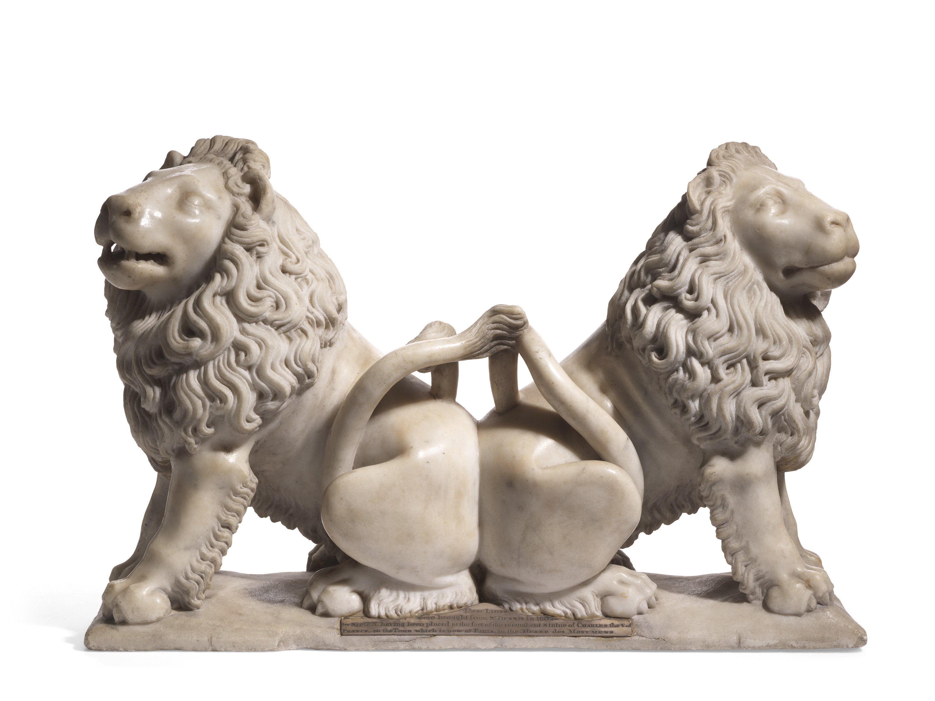 A CARVED MARBLE GROUP OF TWO ADDORSED LIONS