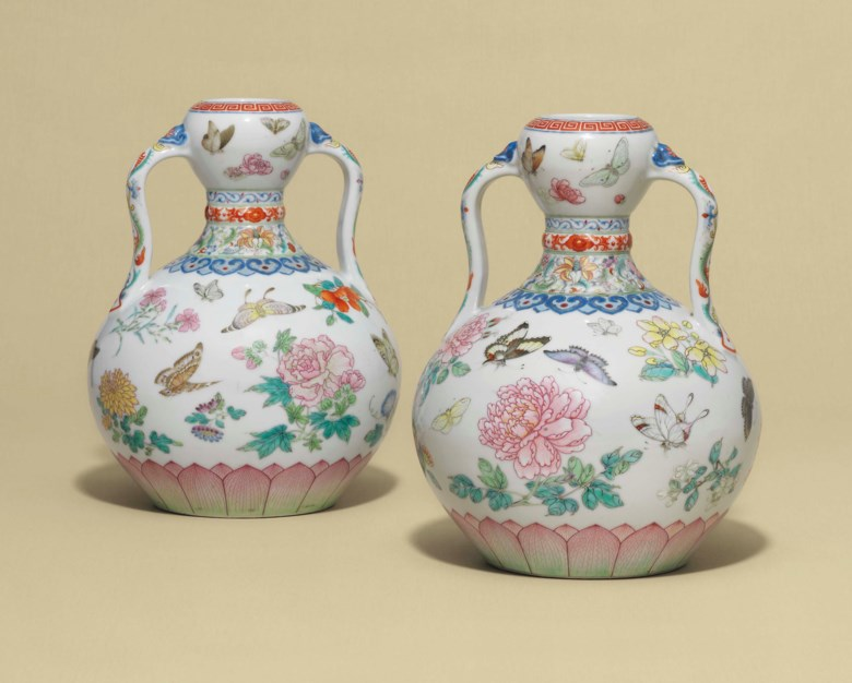 A magnificent pair of famille rose 'butterfly' double-gourd vases, Qianlong six-character seal marks in underglaze blue and of the period (1736-1795). 9  in (23  cm) high. Sold for £14,725,000 on 9 May 2017 at Christie's in London