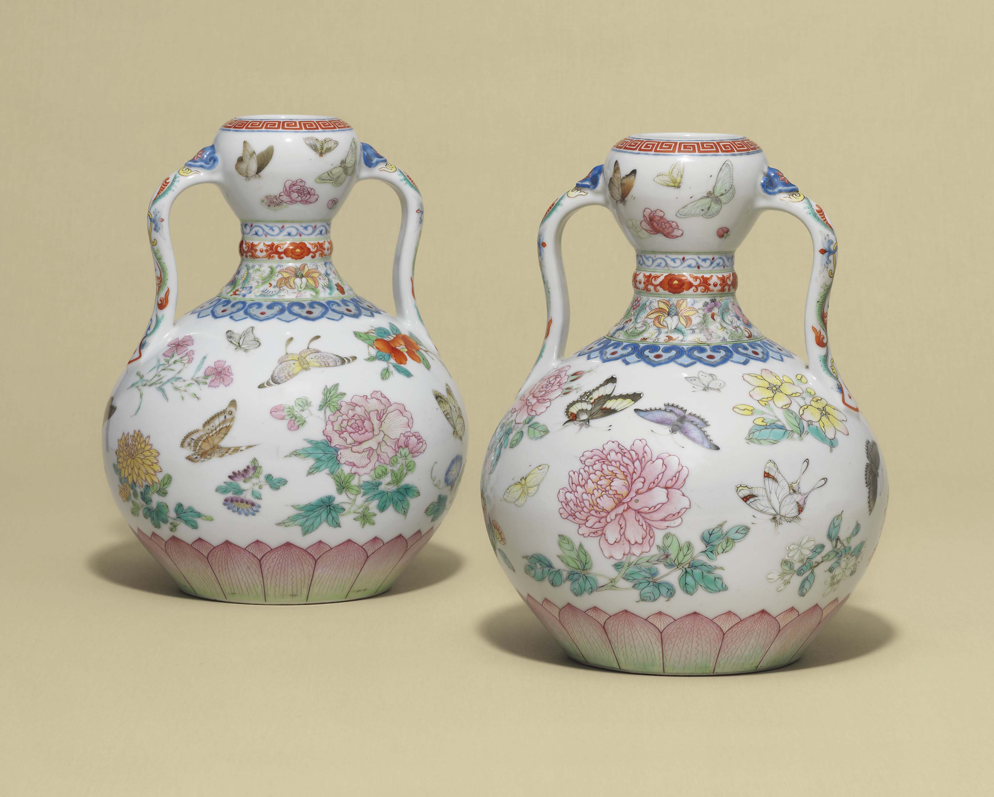A MAGNIFICENT PAIR OF FAMILLE ROSE 'BUTTERFLY' DOUBLE-GOURD VASES