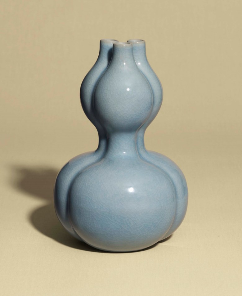 A guan-type trilobed double-gourd-form vase, Qianlong six-character seal mark in underglaze blue and of the period (1736-1795). 7 ½  in (18.8  cm) high. Sold for £245,000 on 9 May 2017 at Christie's in London