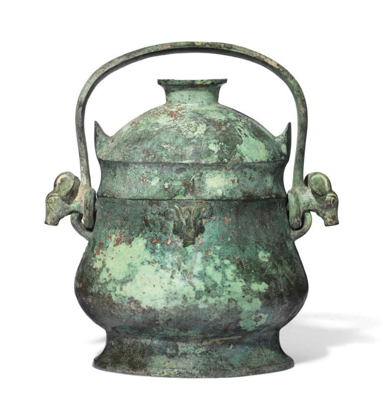 A bronze ritual wine vessel and cover,you, early Western Zhou dynasty (11th-10th century BC). 11 in (28 cm) high. Sold for £608,750 in Fine Chinese Ceramics & Works of Art on 7 November at Christie's London