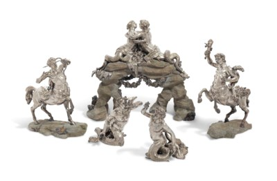 A GROUP OF SILVER-PLATED FIGUR