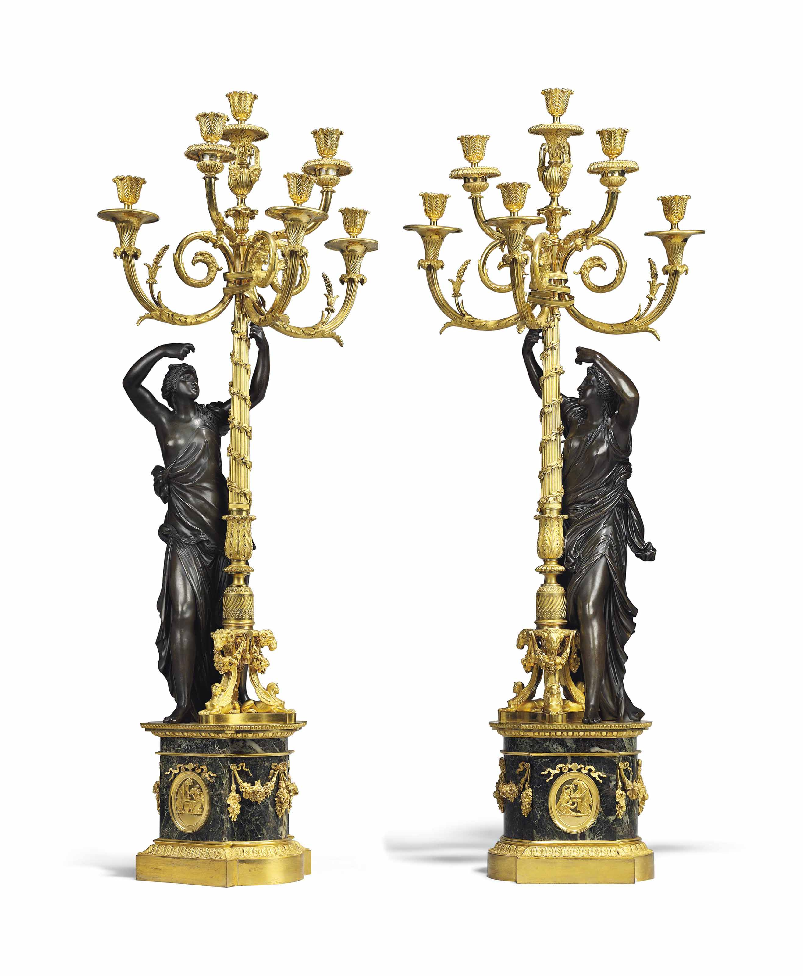 A PAIR OF LATE LOUIS XVI ORMOLU AND PATINATED-BRONZE SIX-LIGHT CANDELABRA