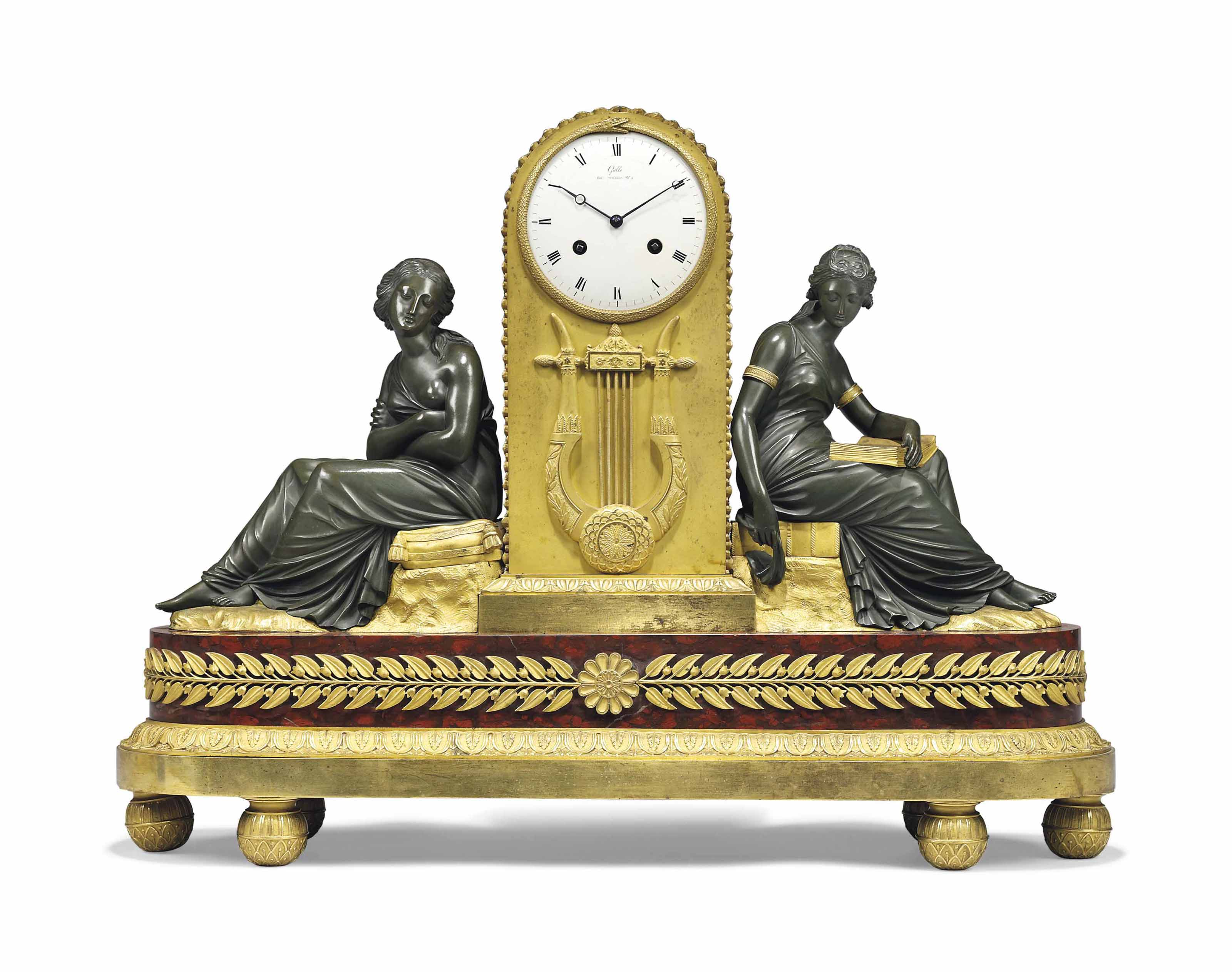 AN EMPIRE ORMOLU, PATINATED-BRONZE AND ROUGE GRIOTTE MARBLE STRIKING MANTEL CLOCK