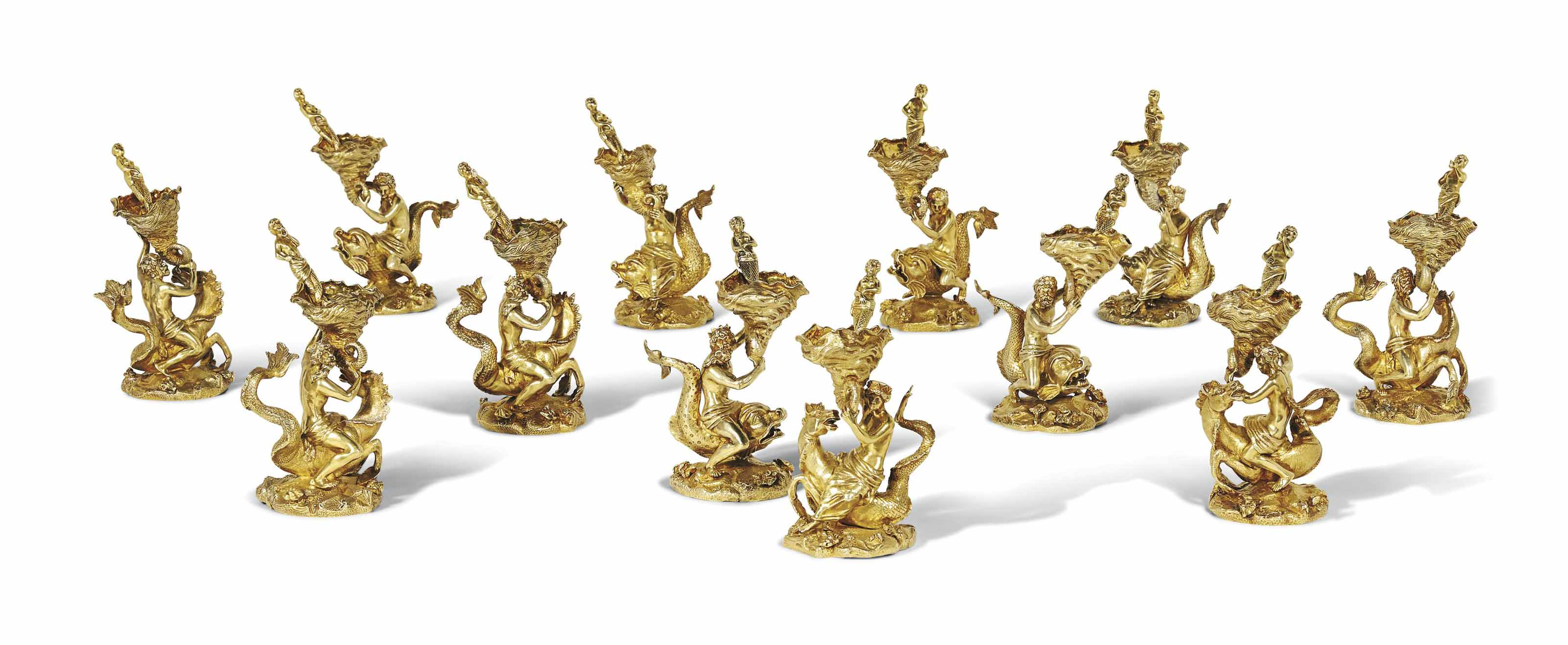 A SET OF TWELVE GEORGE III SILVER-GILT SALT-CELLARS AND TWELVE SALT-SPOONS
