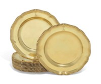 A SET OF TWELVE EDWARD VII SILVER-GILT DINNER-PLATES