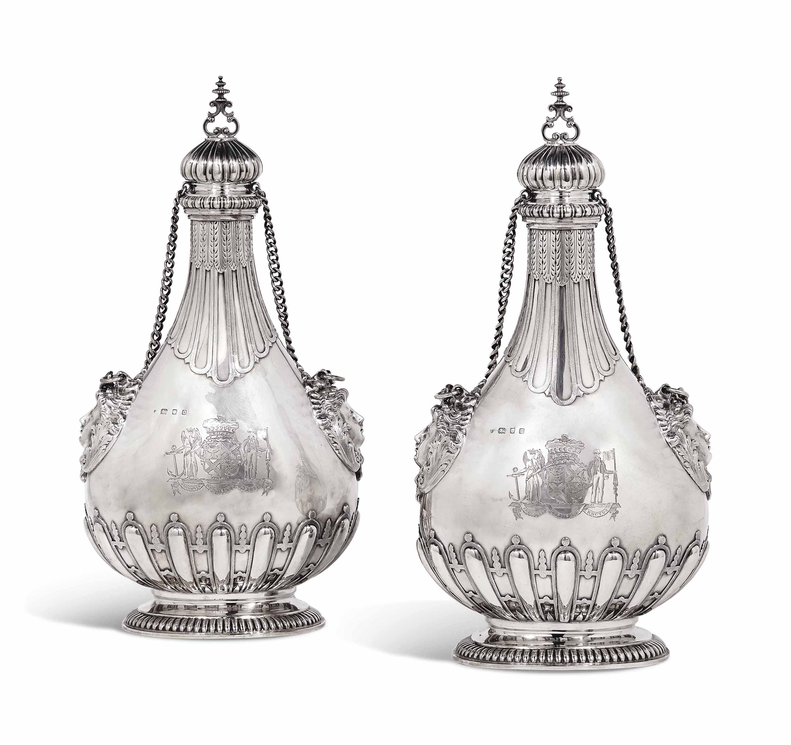 A PAIR OF GEORGE V SILVER PILGRIM FLASKS