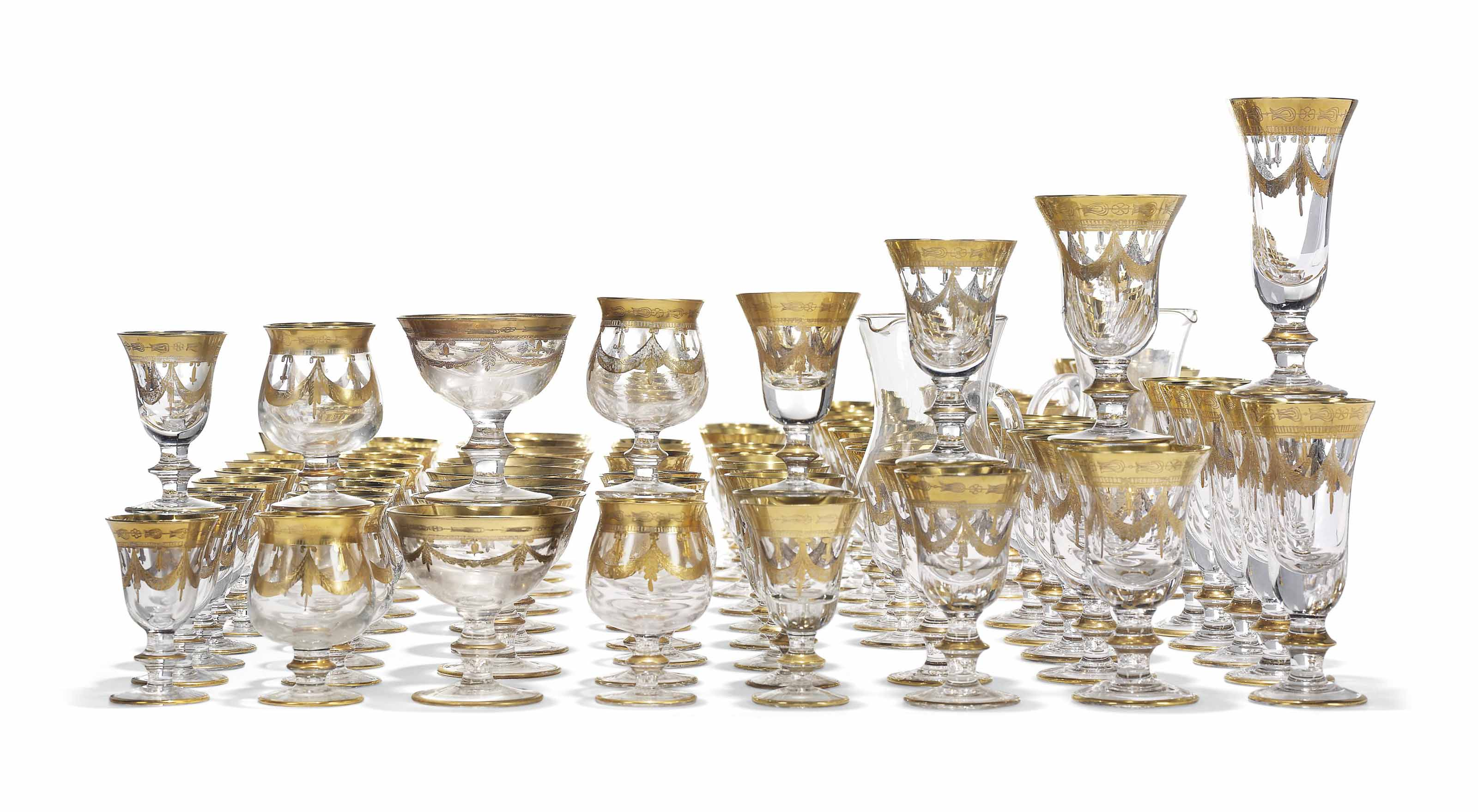 AN EXTENSIVE GILT-DECORATED PART GLASS-SERVICE