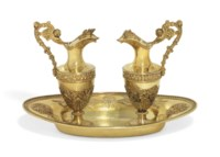 A PAIR OF FRENCH SILVER-GILT ALTAR-CRUETS AND AN ASSOCIATED STAND