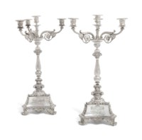 A GEORGE IV AND A WILLIAM IV SILVER FOUR-LIGHT CANDELABRA
