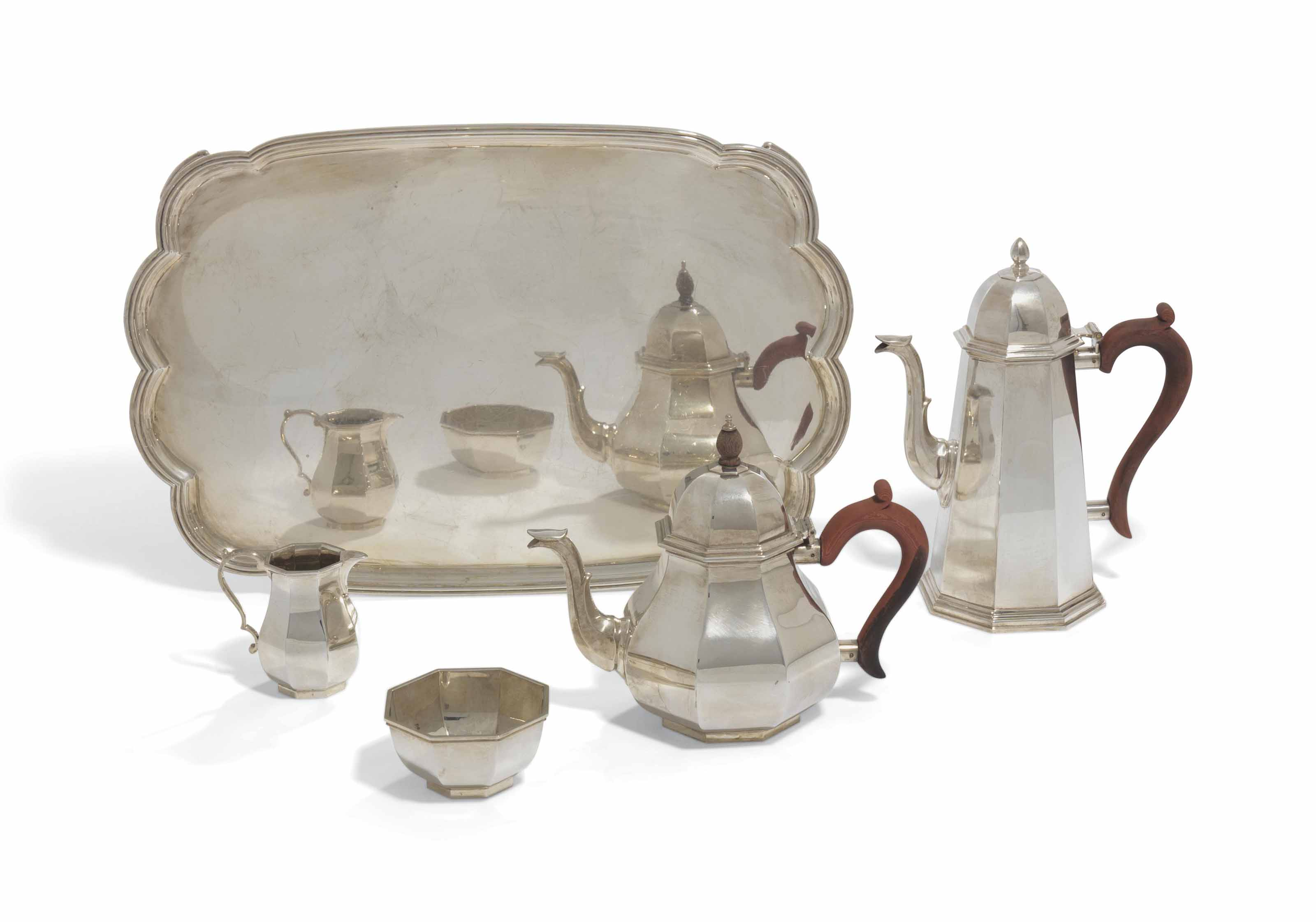 AN ELIZABETH II SILVER TEA AND COFFEE-SERVICE WITH A TRAY EN...
