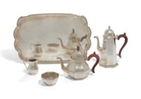 AN ELIZABETH II SILVER TEA AND COFFEE-SERVICE WITH A TRAY EN SUITE
