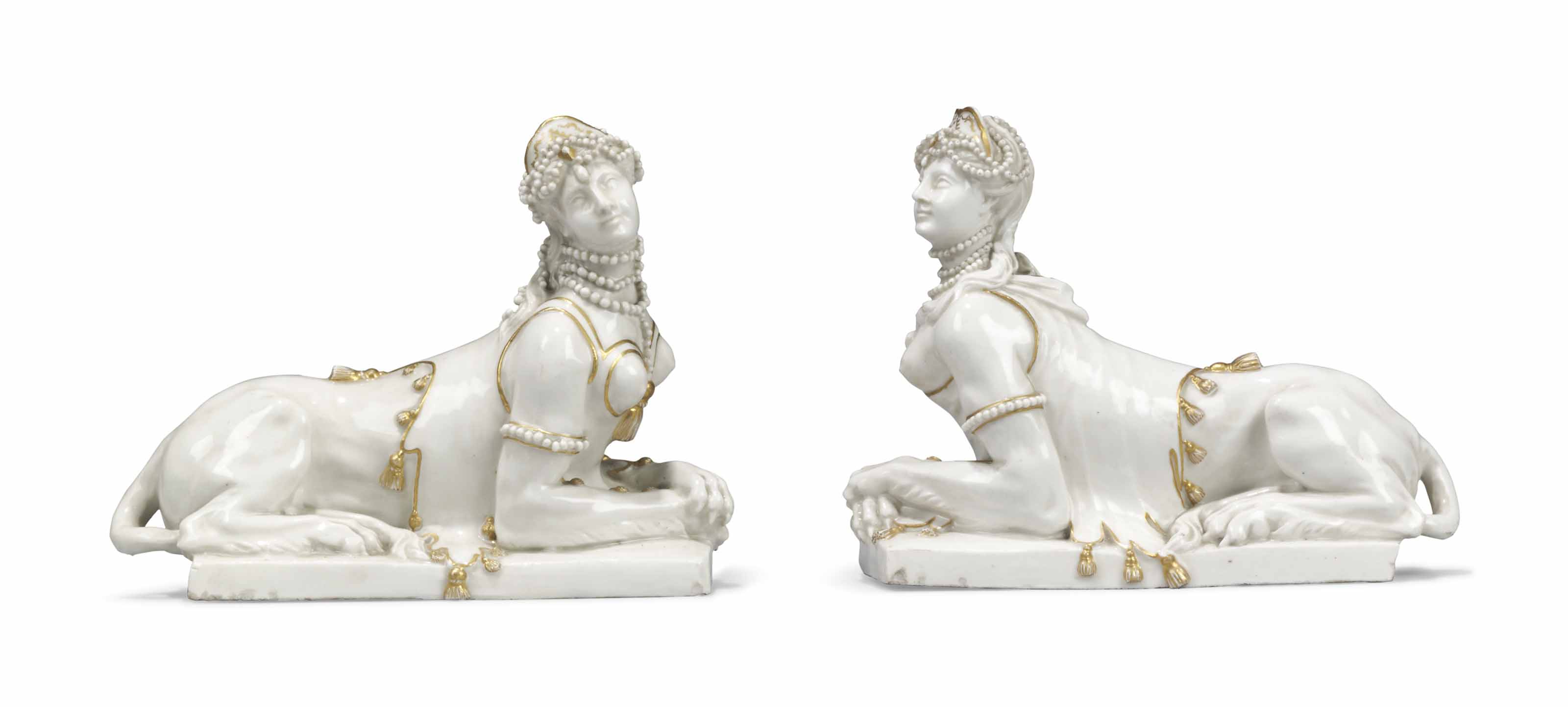 A PAIR OF LUDWIGSBURG WHITE AND GILT MODELS OF SPHINXES