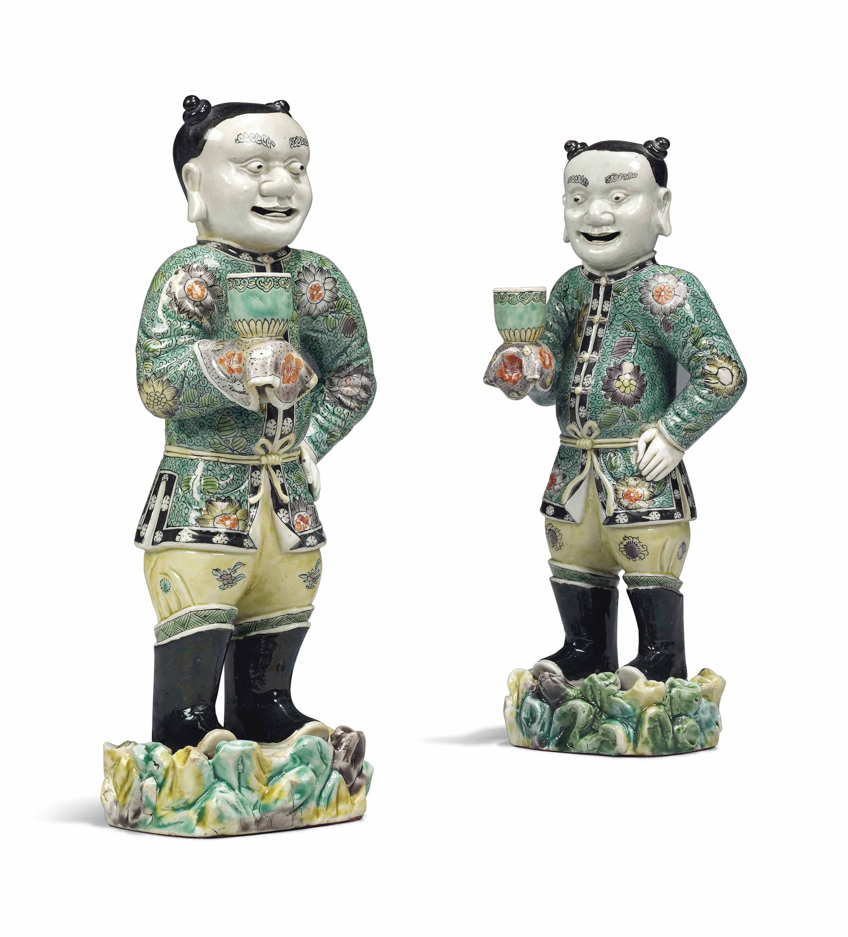 A PAIR OF RARE CHINESE FAMILLE VERTE BISCUIT FIGURES OF 'BOY...