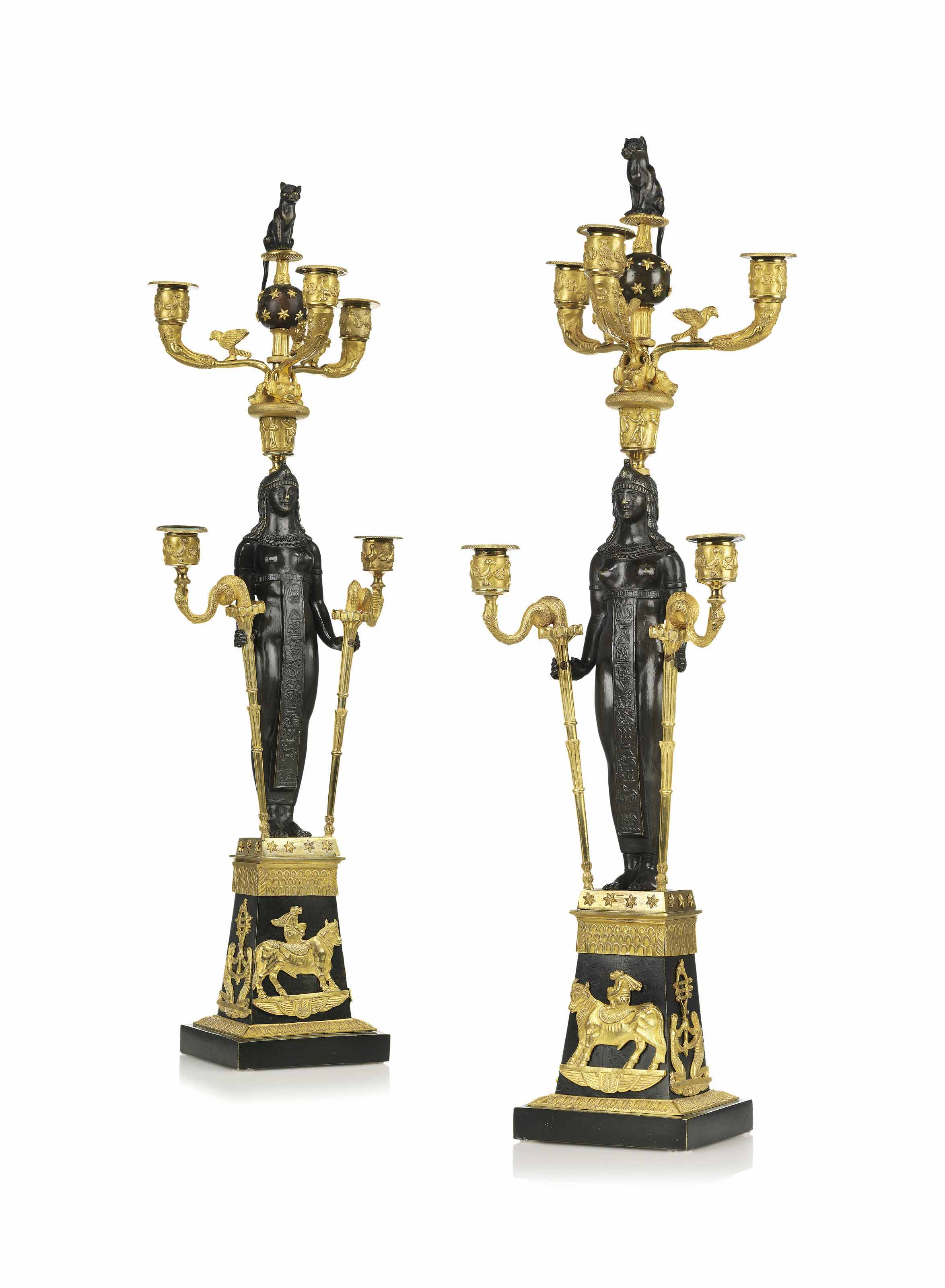 A PAIR OF RUSSIAN ORMOLU AND PATINATED-BRONZE FIVE-LIGHT CANDELABRA