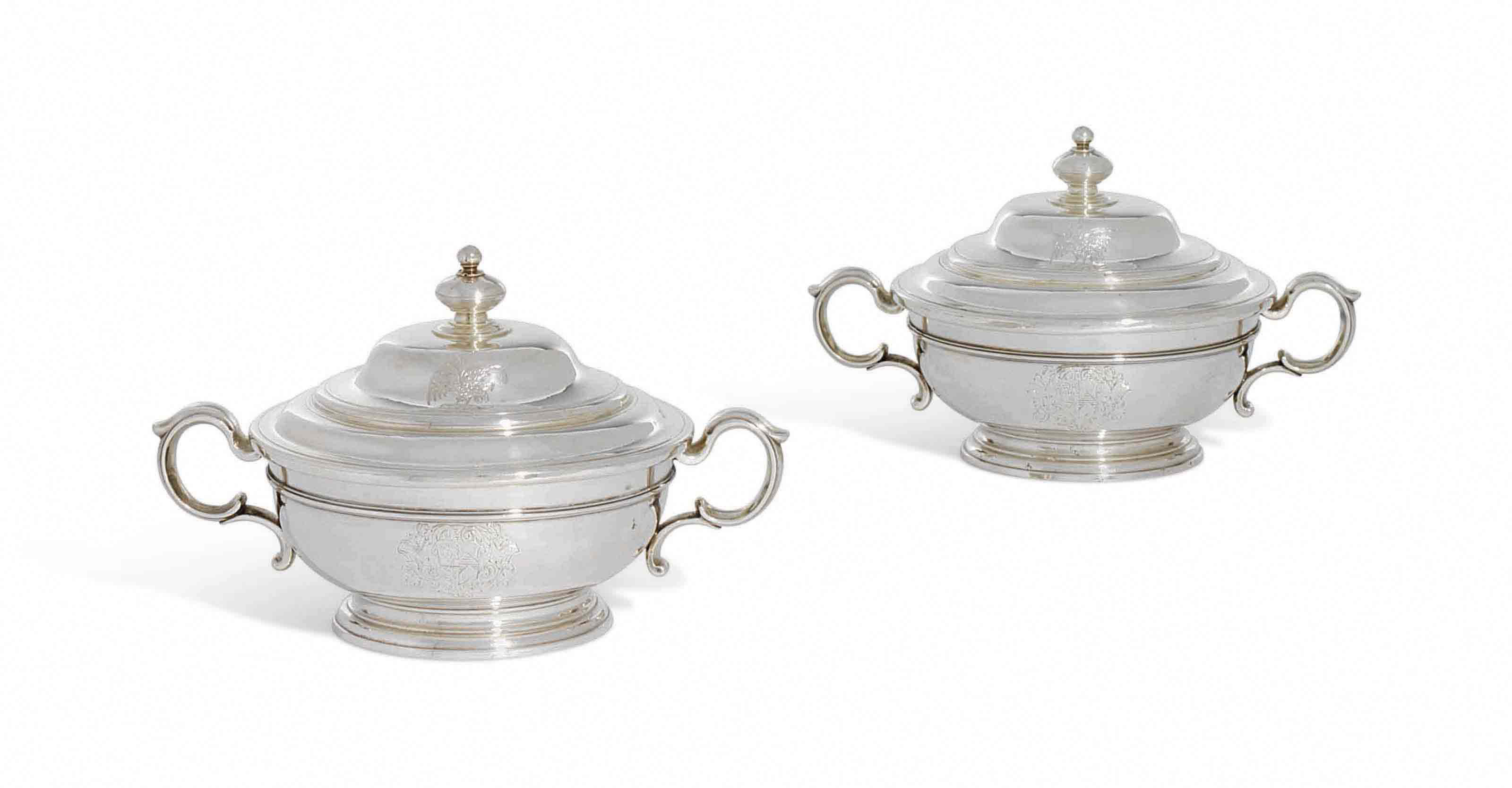A PAIR OF GEORGE I SILVER BOWLS AND COVERS
