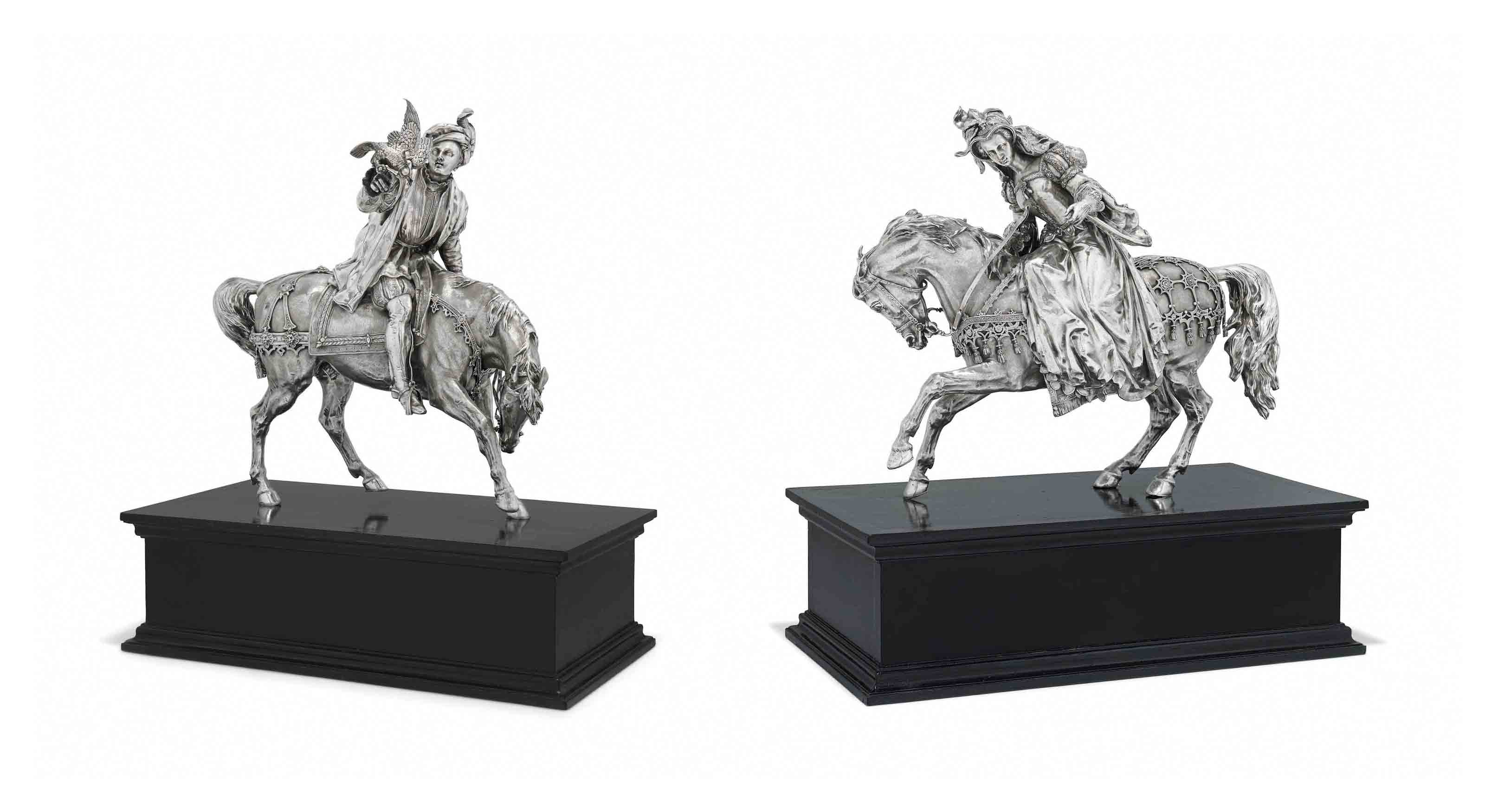 A PAIR OF VICTORIAN SILVER FIGURES ON HORSEBACK