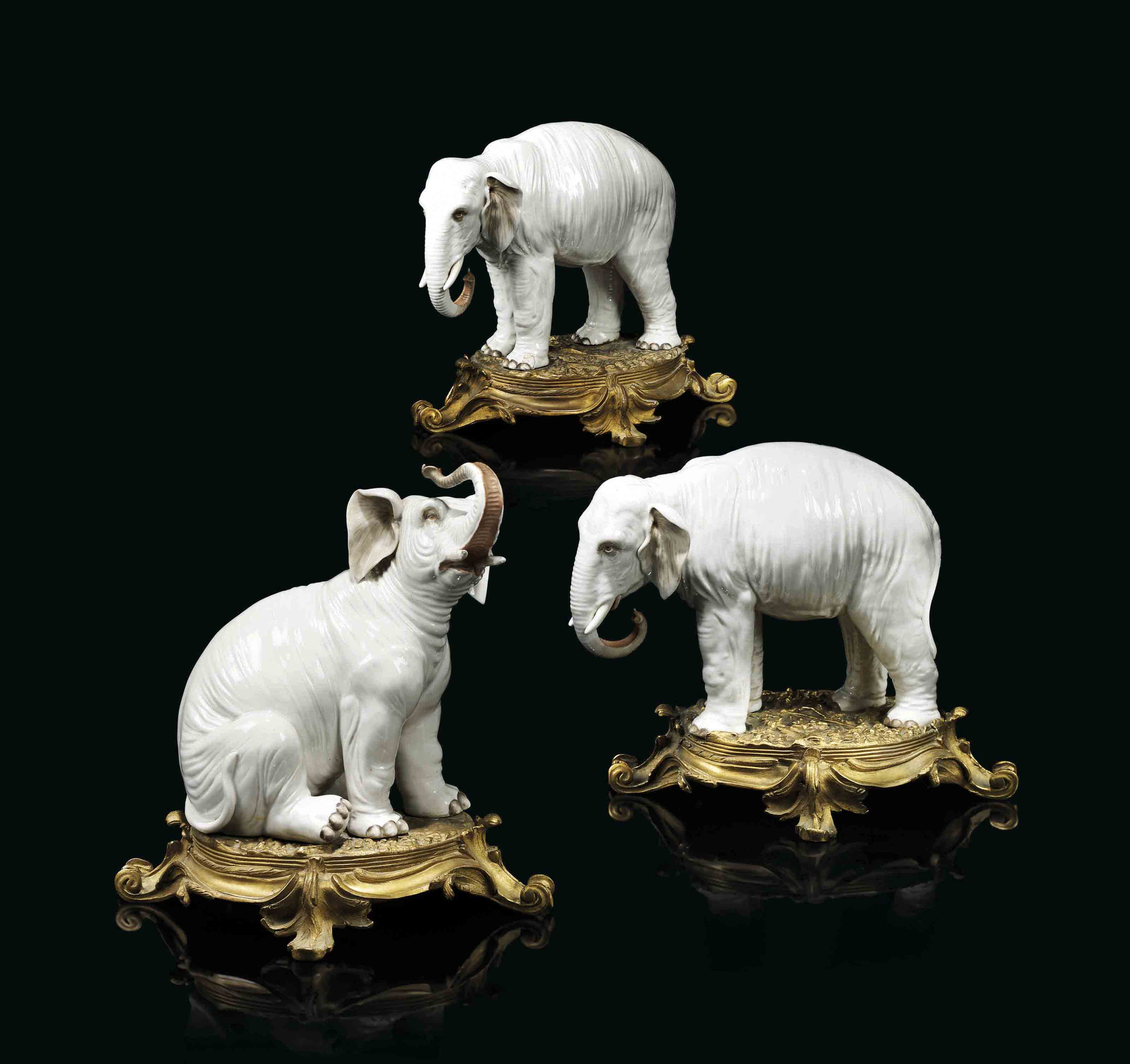 A GROUP OF THREE ORMOLU-MOUNTED PORCELAIN MODELS OF ELEPHANTS