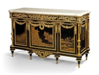 A FRENCH ORMOLU-MOUNTED JAPANESE GOLD IRAMAKI-E LACQUER AND EBONY COMMODE