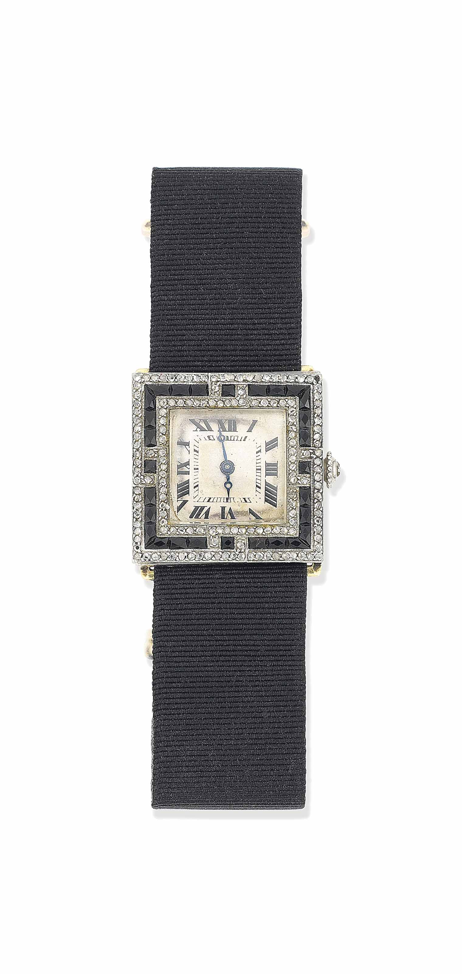 AN ART DECO ONYX AND DIAMOND WRISTWATCH, BY CARTIER