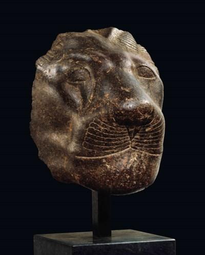 AN EGYPTIAN GRANITE HEAD OF SE