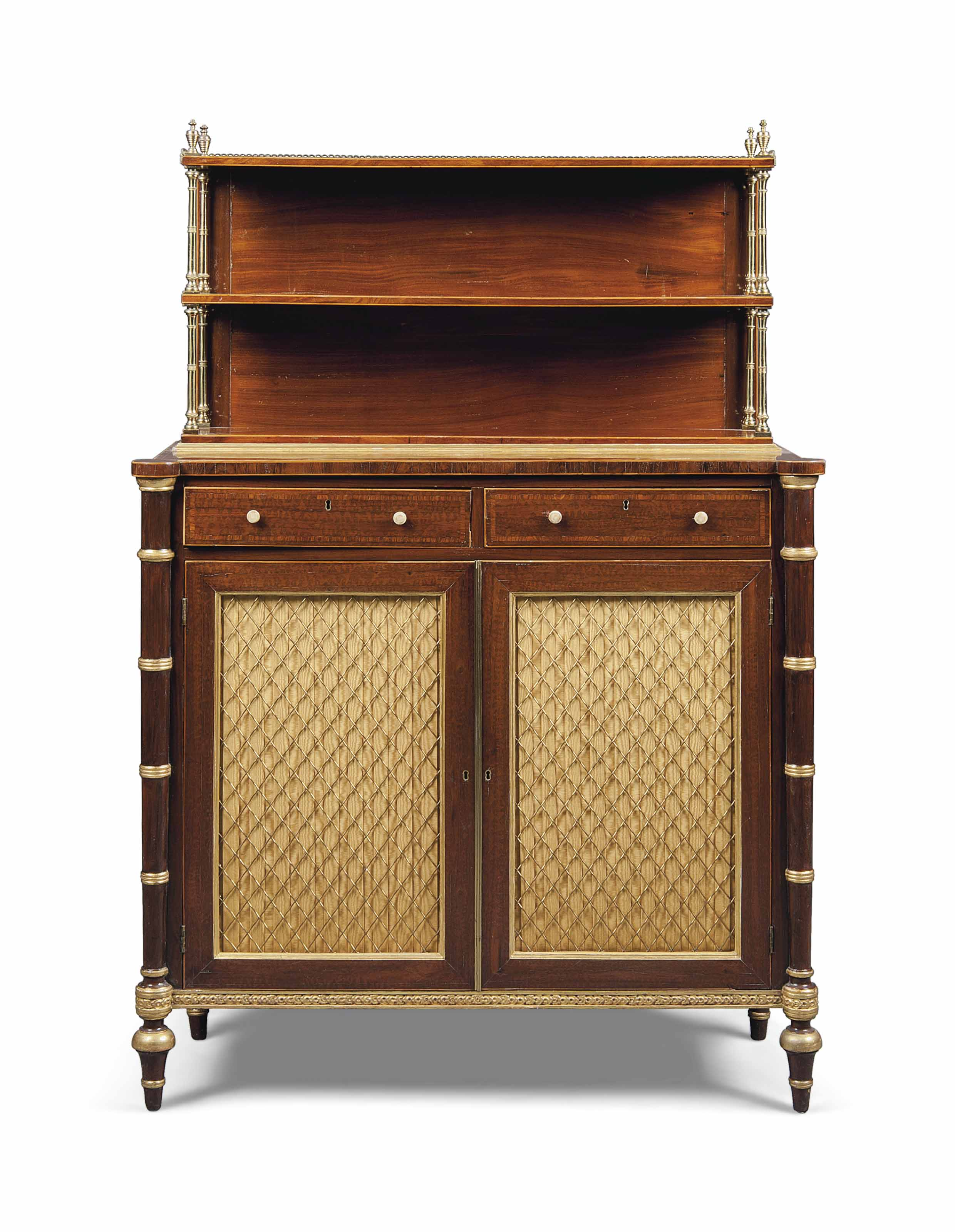 A REGENCY ROSEWOOD CROSSBANDED, SNAKEWOOD, GRAINED ROSEWOOD AND PARCEL-GILT CHIFFONIER