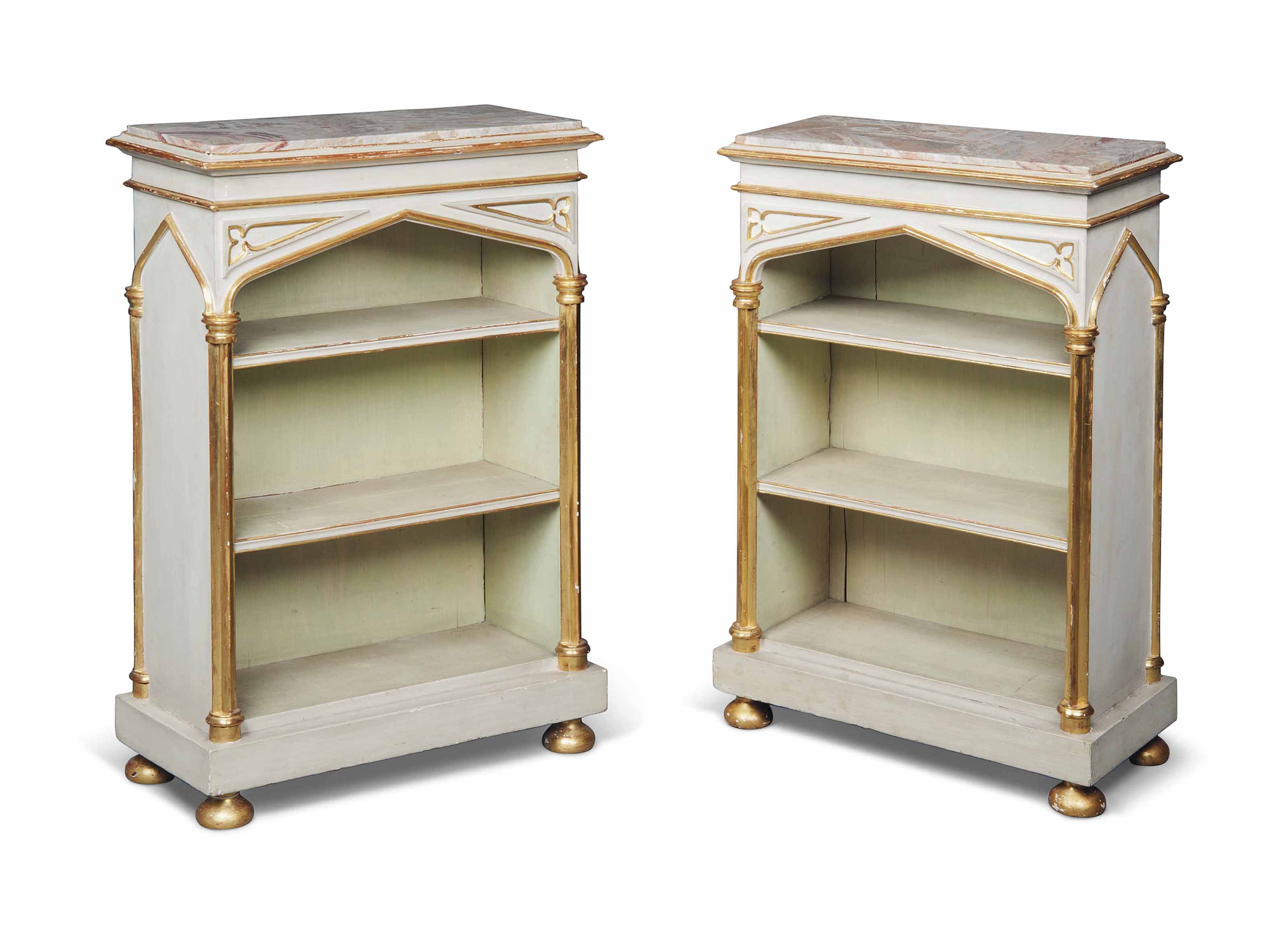 A PAIR OF REGENCY WHITE AND GREEN-PAINTED AND PARCEL-GILT GOTHIC BOOKCASES
