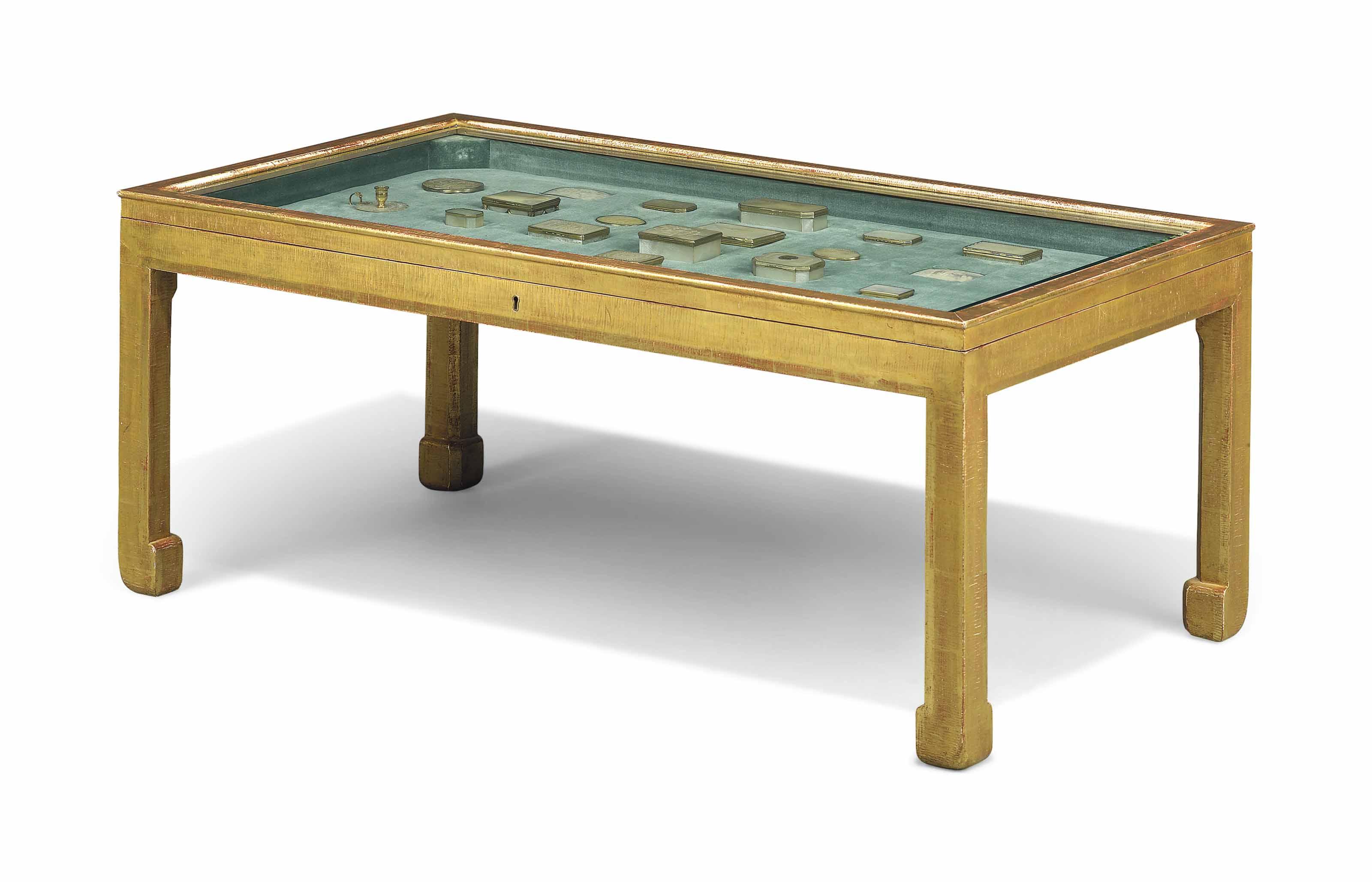 A GILTWOOD DISPLAY TABLE