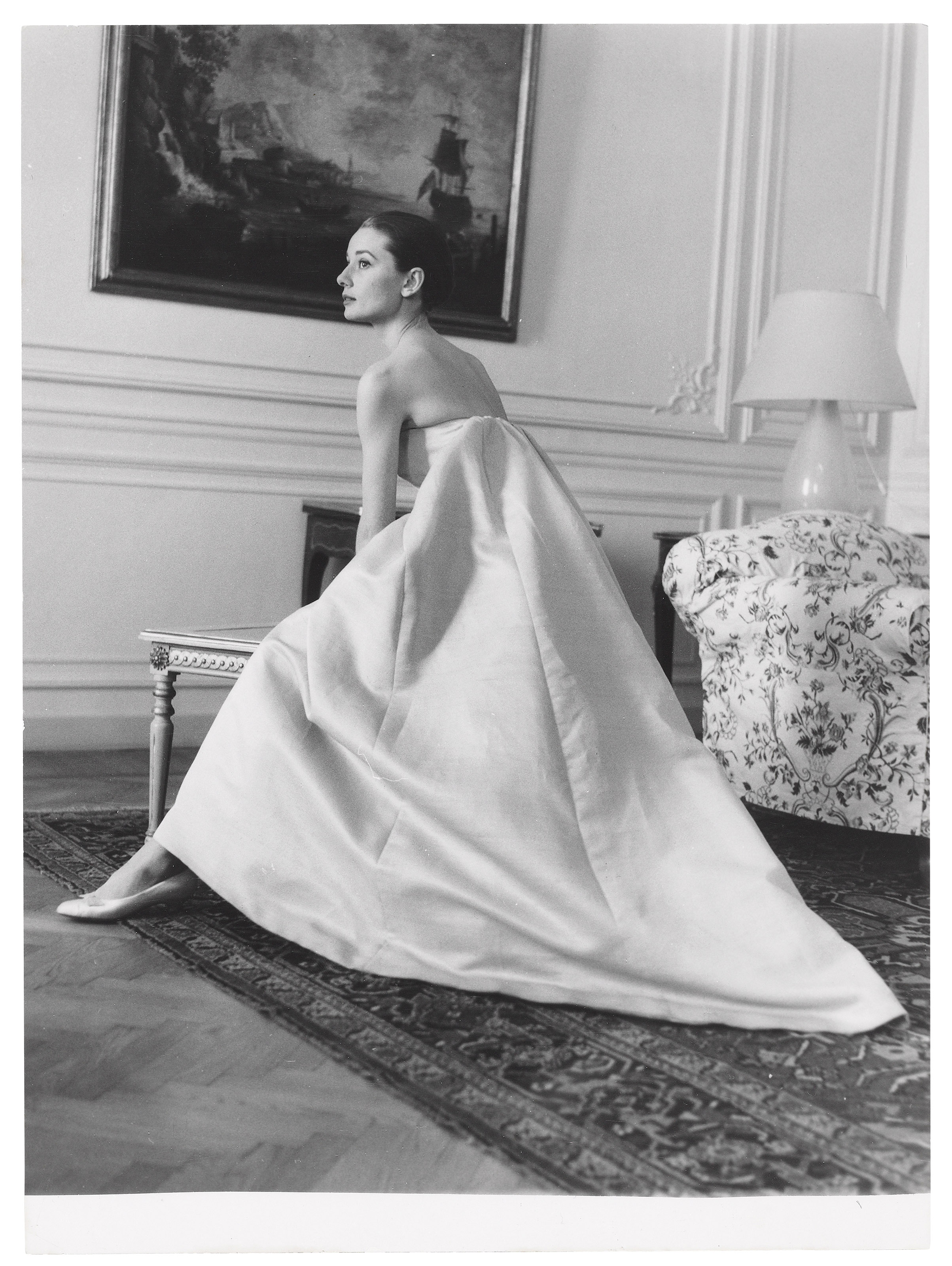 Audrey Hepburn at a dress fitting with Hubert de Givenchy for the premiere of The Nun's Story, circa 1959