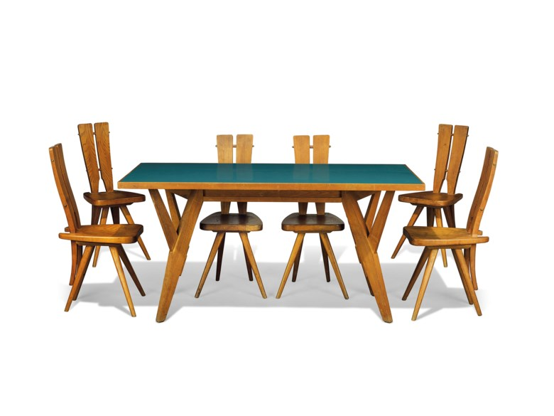 Carlo Mollino (1905-1973), a rare and important dining suite executed by Ettore Canali, Brescia, for the Casa del Sole, Cervinia. Comprising a table and six chairs, oak, chestnut, brass bolts, table with laminate-veneered surface table 31⅛ high x 62¾ long x 31¾ in wide (79 x 159.5 x 79.5 cm). Chairs each 36½ in (93 cm.) high. Designed in 1953, this suite was executed circa