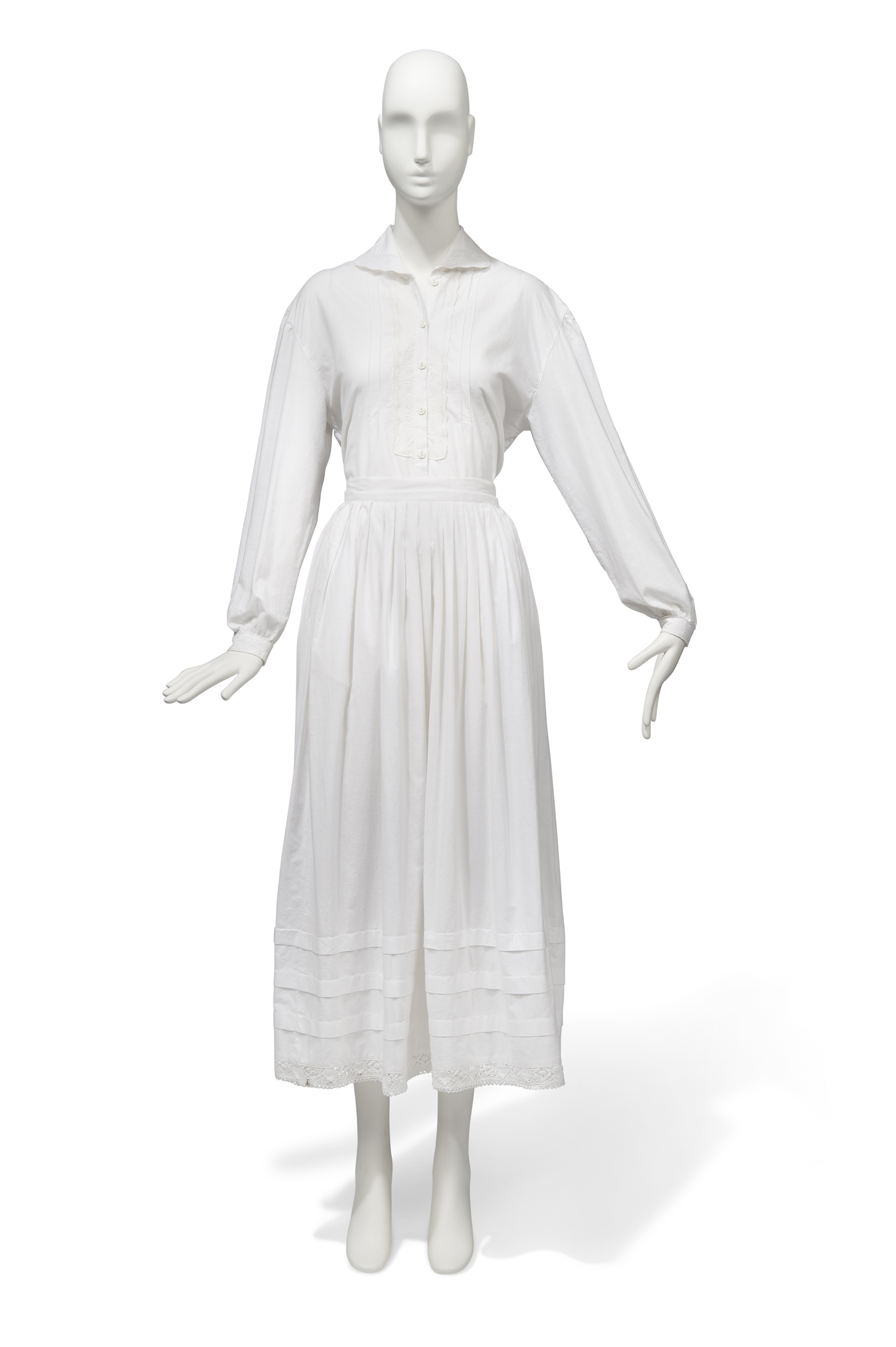 A WHITE COTTON BLOUSE AND MATCHING SKIRT