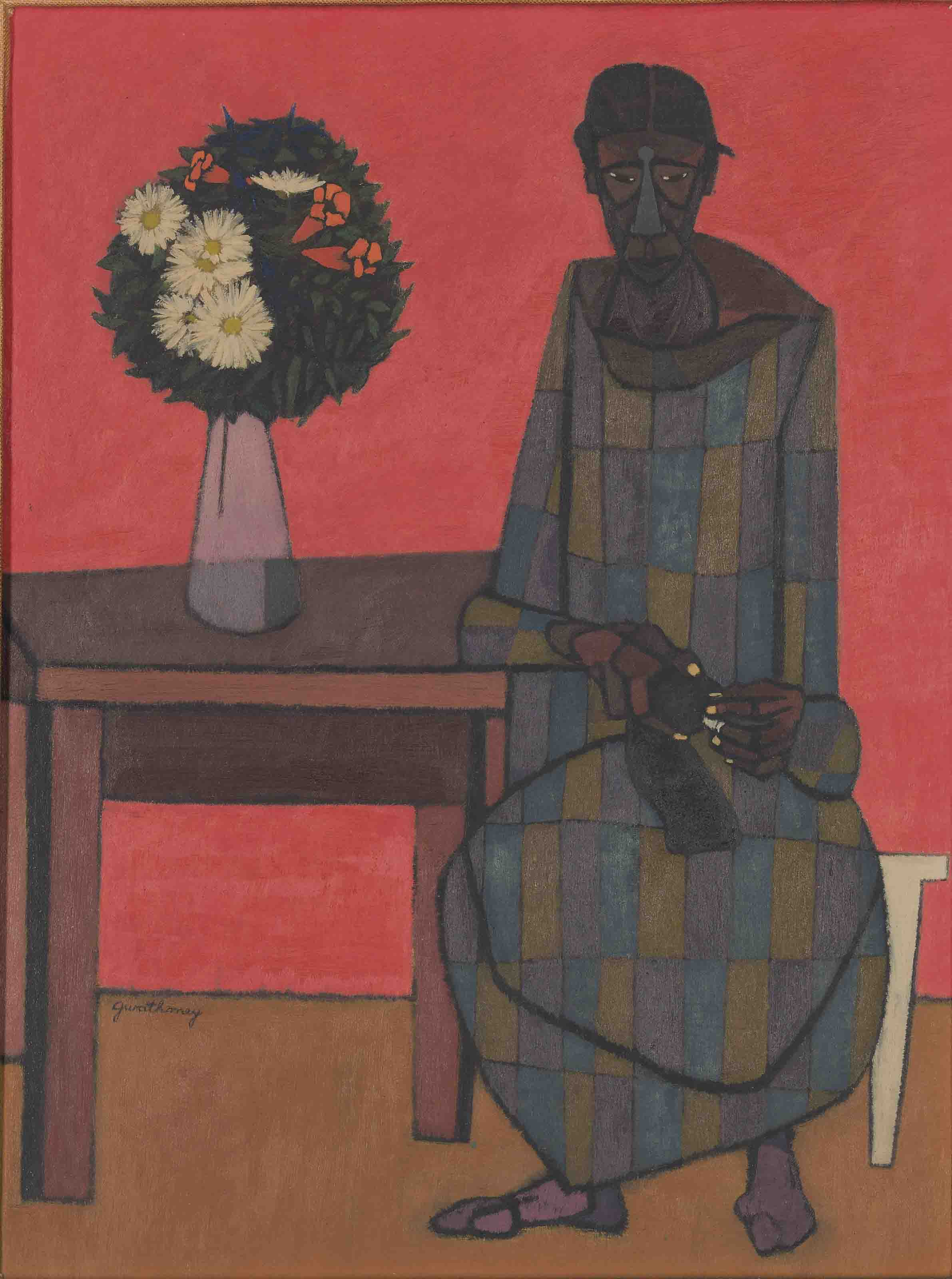 Woman seated by a table
