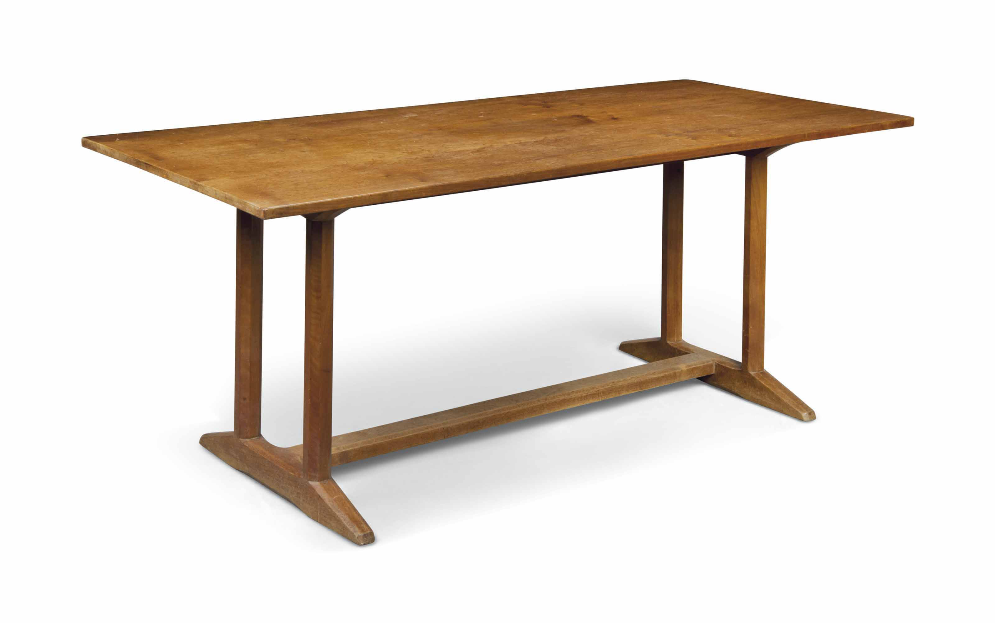 A GORDON RUSSELL WALNUT REFECTORY TABLE ON OCTAGONAL SUPPORTS UNITED BY CHAMFERED FEET AND STRETCHER