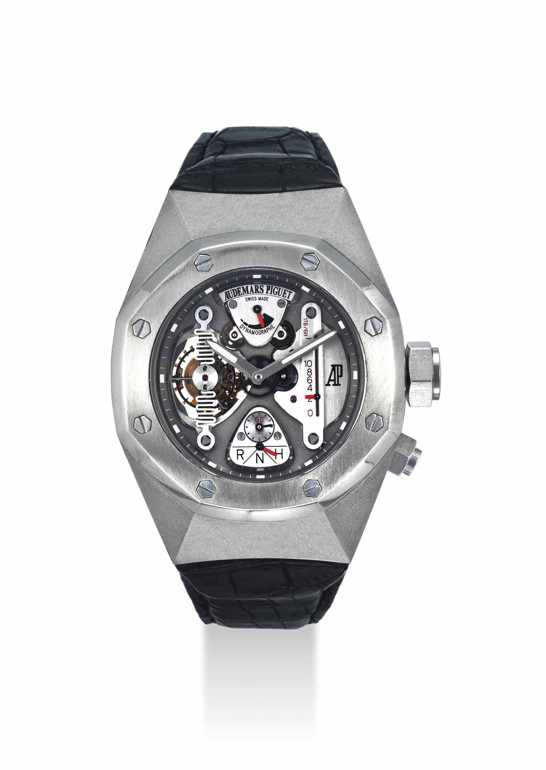 AUDEMARS PIGUET. A VERY FINE AND IMPORTANT ALACRITE 602 AND TITANIUM LIMITED EDITION TONNEAU-SHAPED SEMI-SKELETONIZED TOURBILLON WRISTWATCH WITH POWER RESERVE AND DYNAMOGRAPH INDICATION