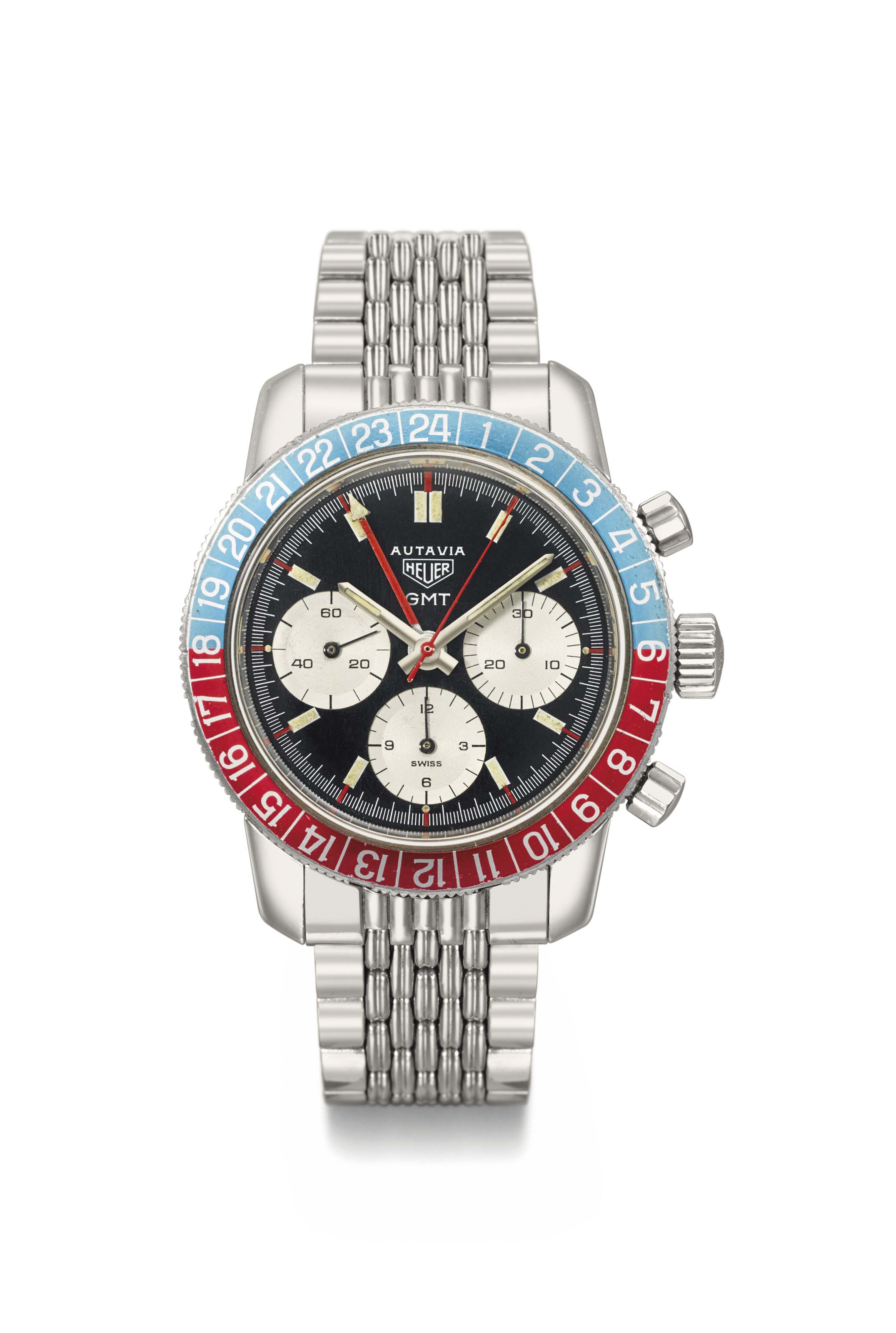 Heuer. A fine stainless steel dual time chronograph wristwatch with bracelet