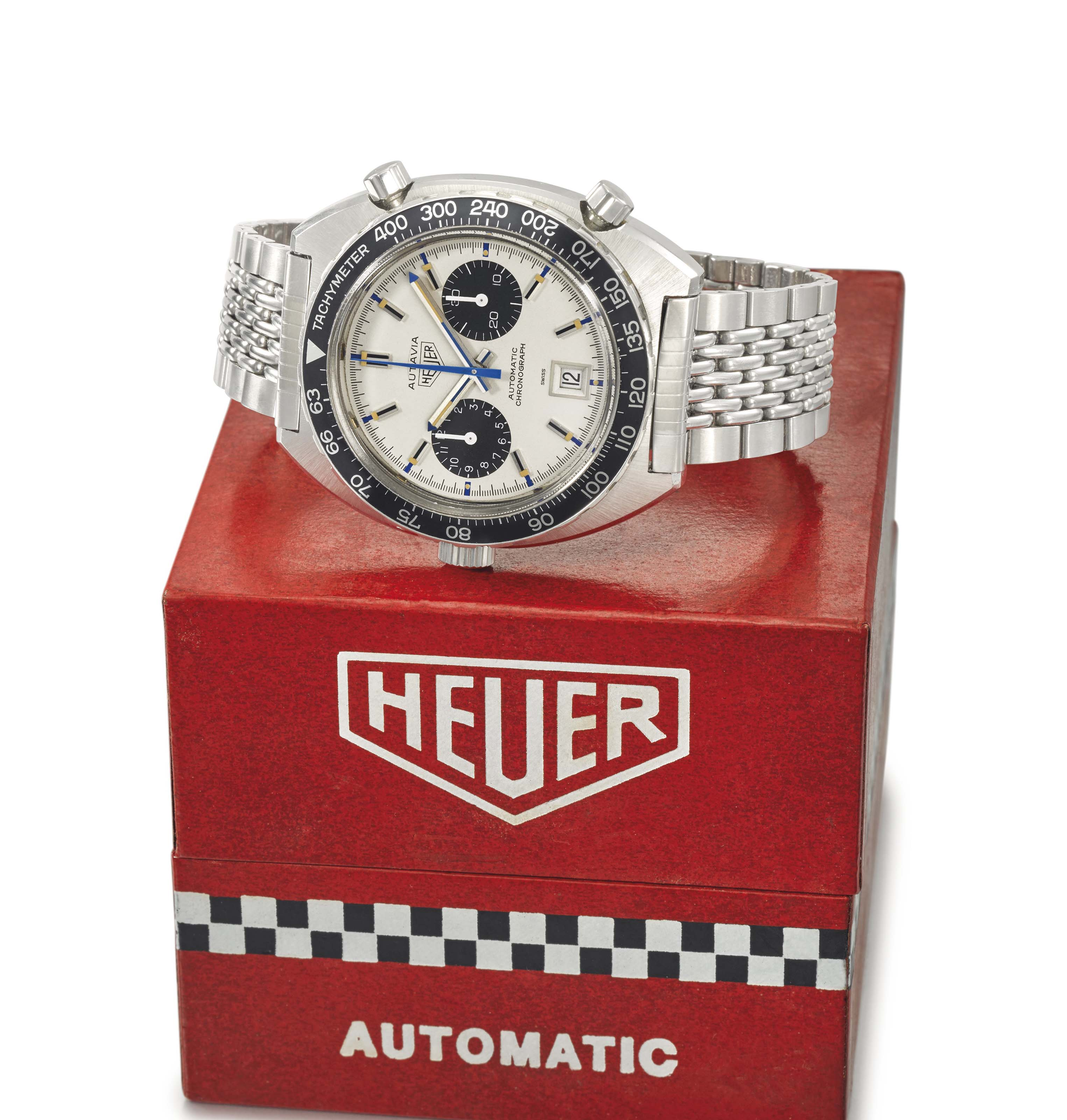 Heuer. A rare and large stainless steel tonneau-shaped automatic chronograph wristwatch with date