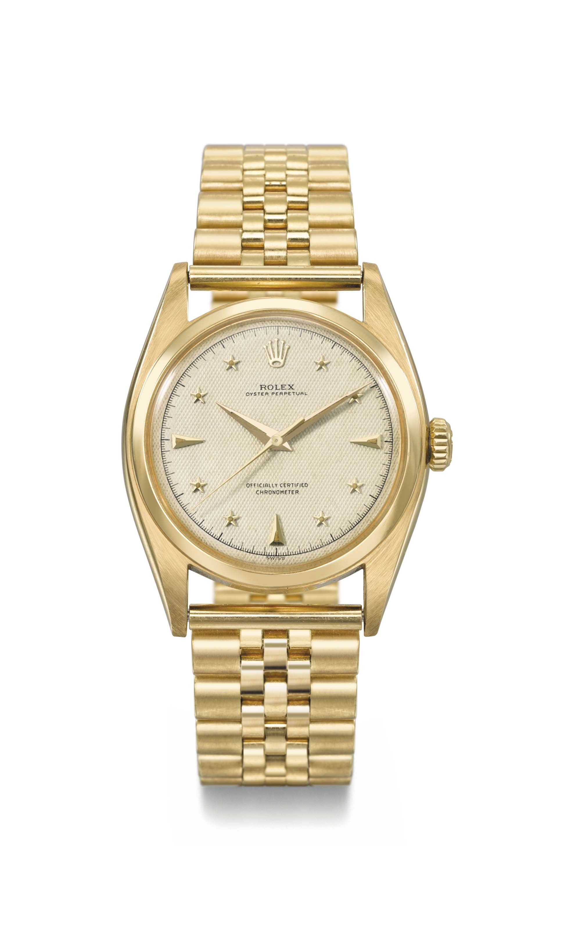 Rolex. A highly attractive and extremely rare 18K gold automatic sweep centre seconds wristwatch with luminous honeycomb star dial, gilt movement and bracelet