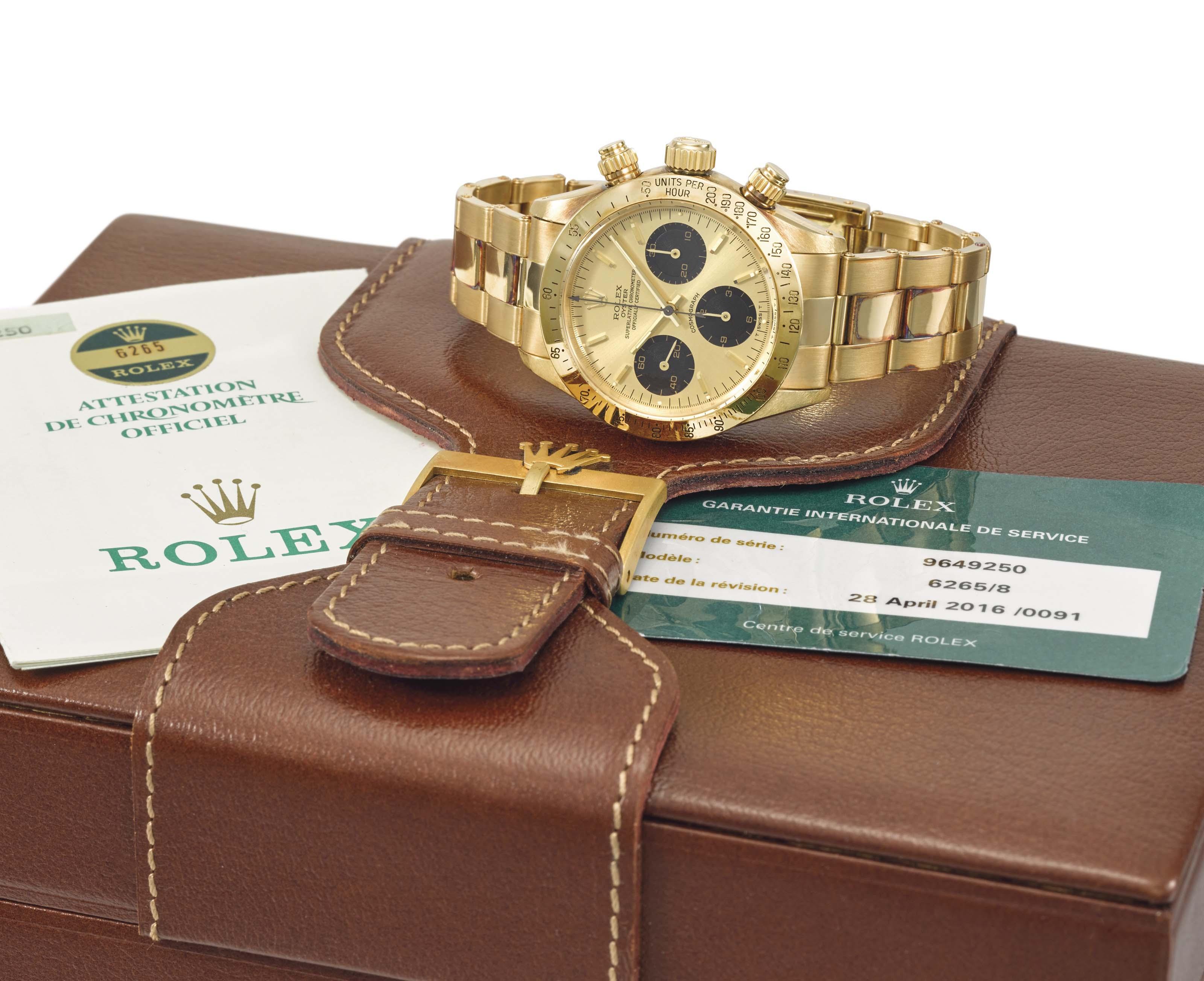 Rolex A very rare and very fine 18K gold chronograph wristwa...
