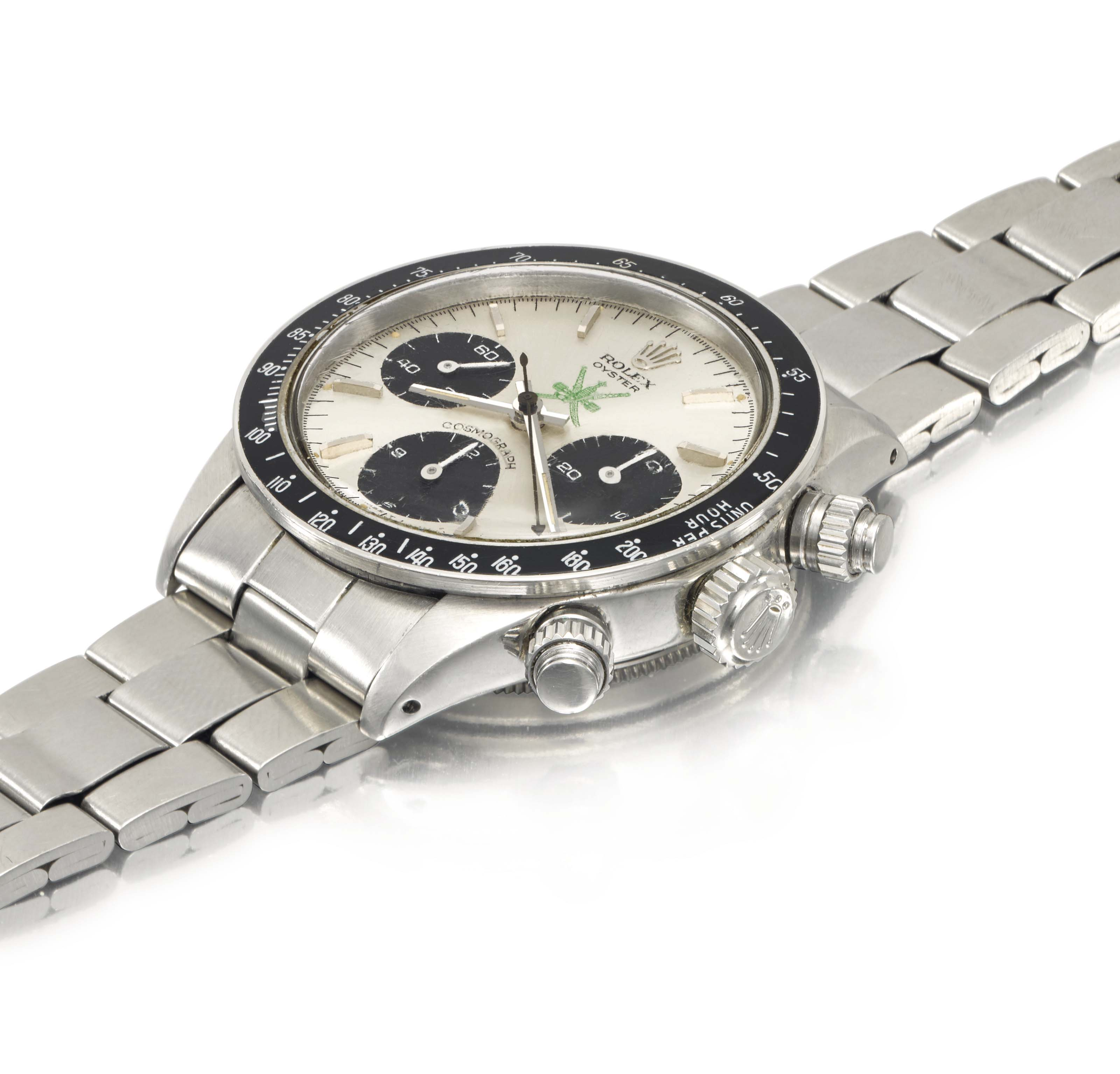 Rolex. An exceptionally rare stainless steel chronograph wristwatch with green «Khanjar» symbol, presented by the Sultan of Oman to the current owner in 1974, sold with the original sales tag, box, period blank guarantee and brochures