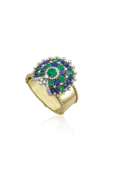 A sapphire, emerald and diamond banglebrooch, by Bulgari. Sold for CHF 77,500 on 17 May 2017 at Christie's in Geneva