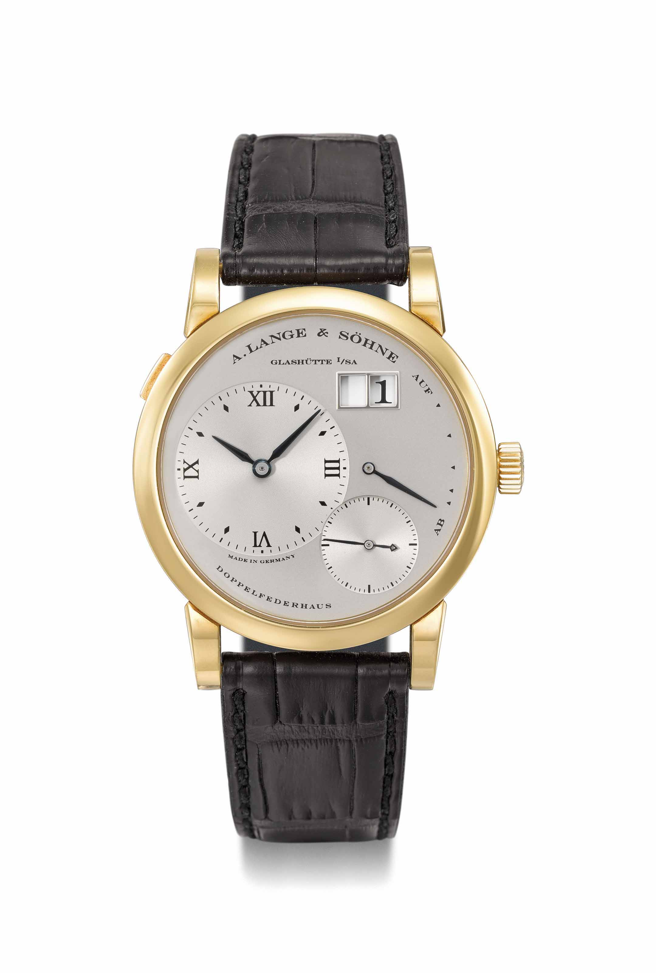 A. Lange & Söhne. A fine 18K gold twin barrel wristwatch with oversized date, power reserve, Garantie and box