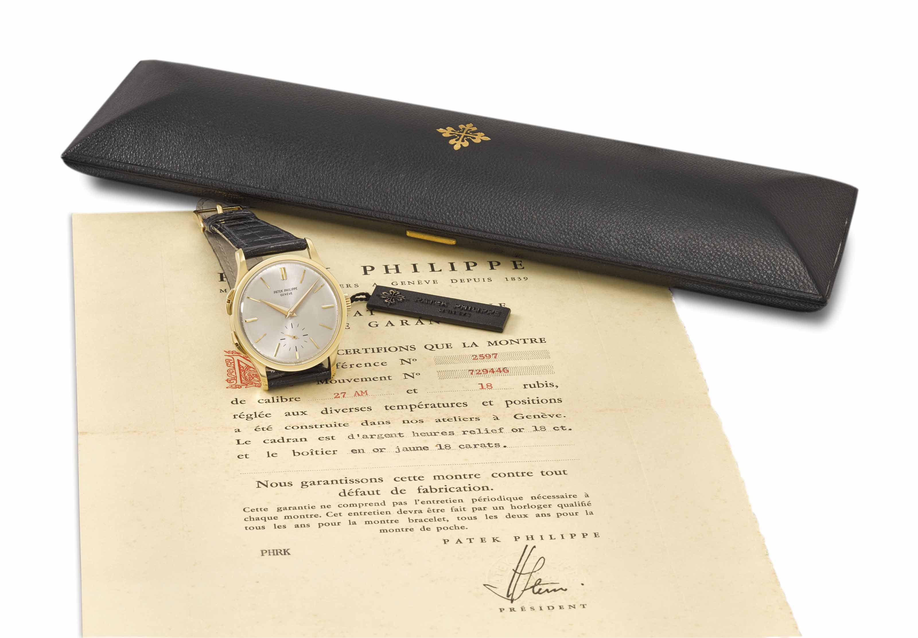 Patek Philippe. An extremely fine and very rare 18K gold dual time zone wristwatch with separately adjustable hour hand, Certificate of Origin, envelope, sales tag and box