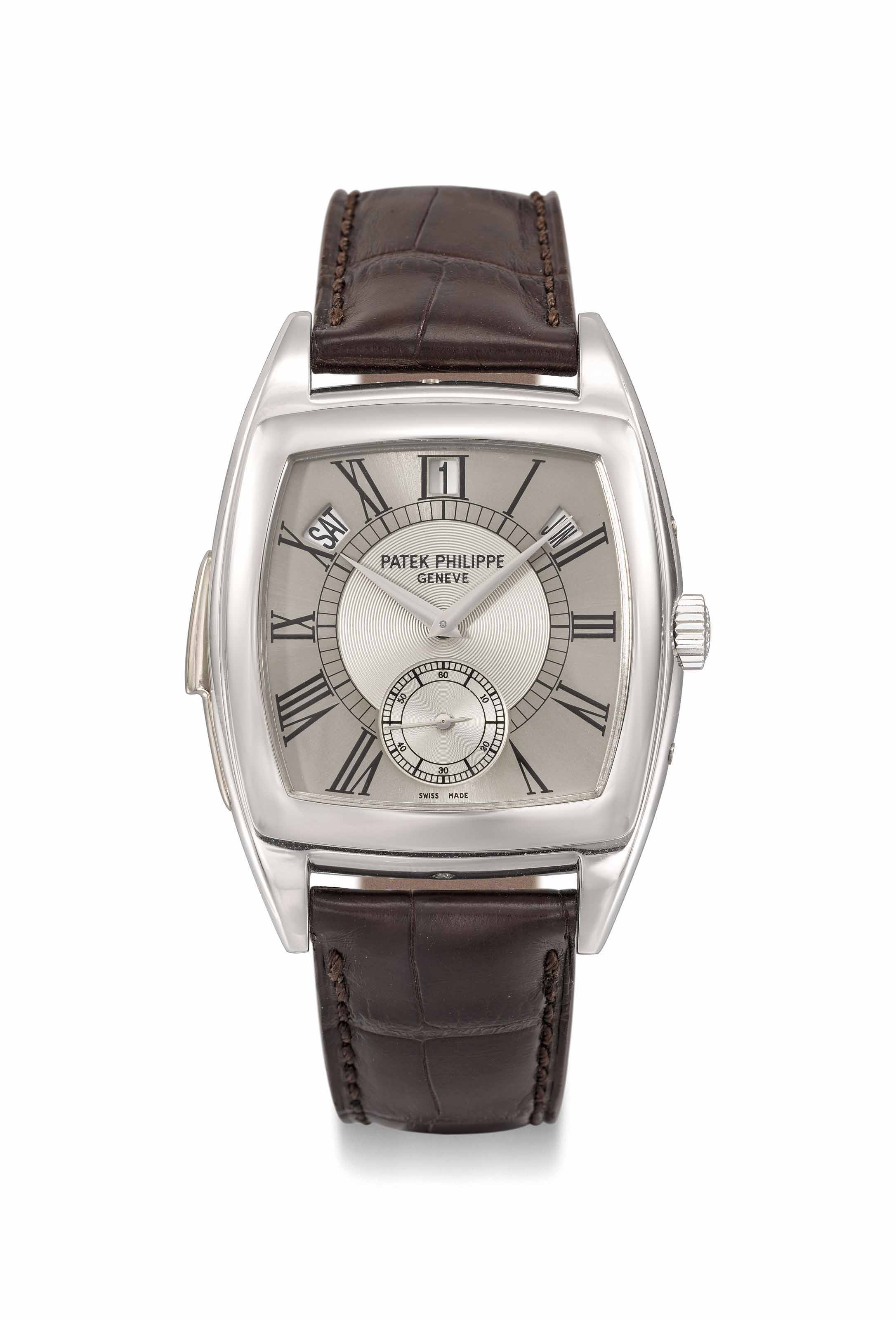 "Patek Philippe. An extremely fine and rare platinum tonneau-shaped automatic ""cathedral"" minute repeating annual calendar wristwatch with two-tone silvered dial and elongated Roman numerals, original sales tag, second case back, setting pin and box"