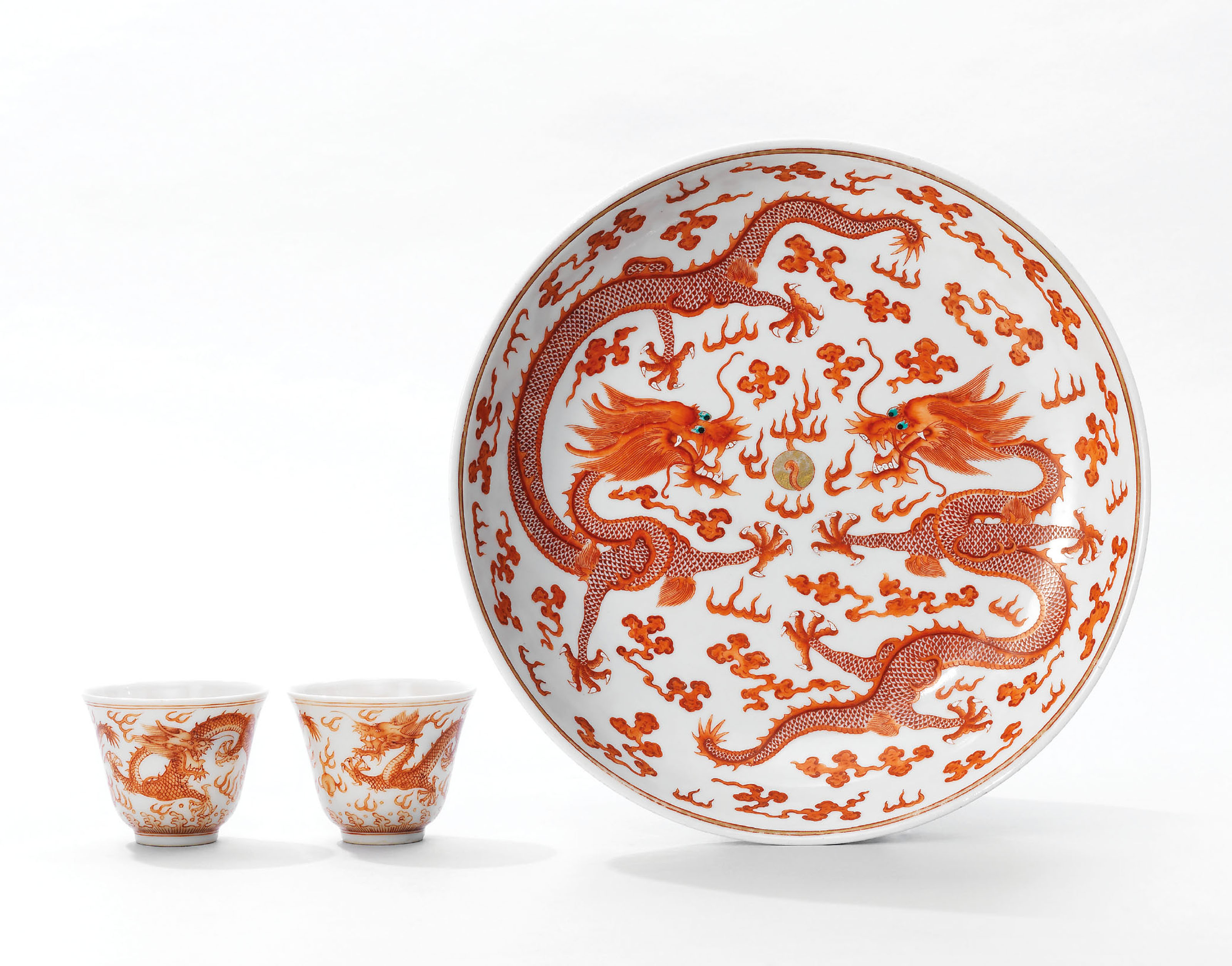 A FINE PAIR OF IRON-RED DECORATED 'DRAGON' CUPS AND AN IRON-...