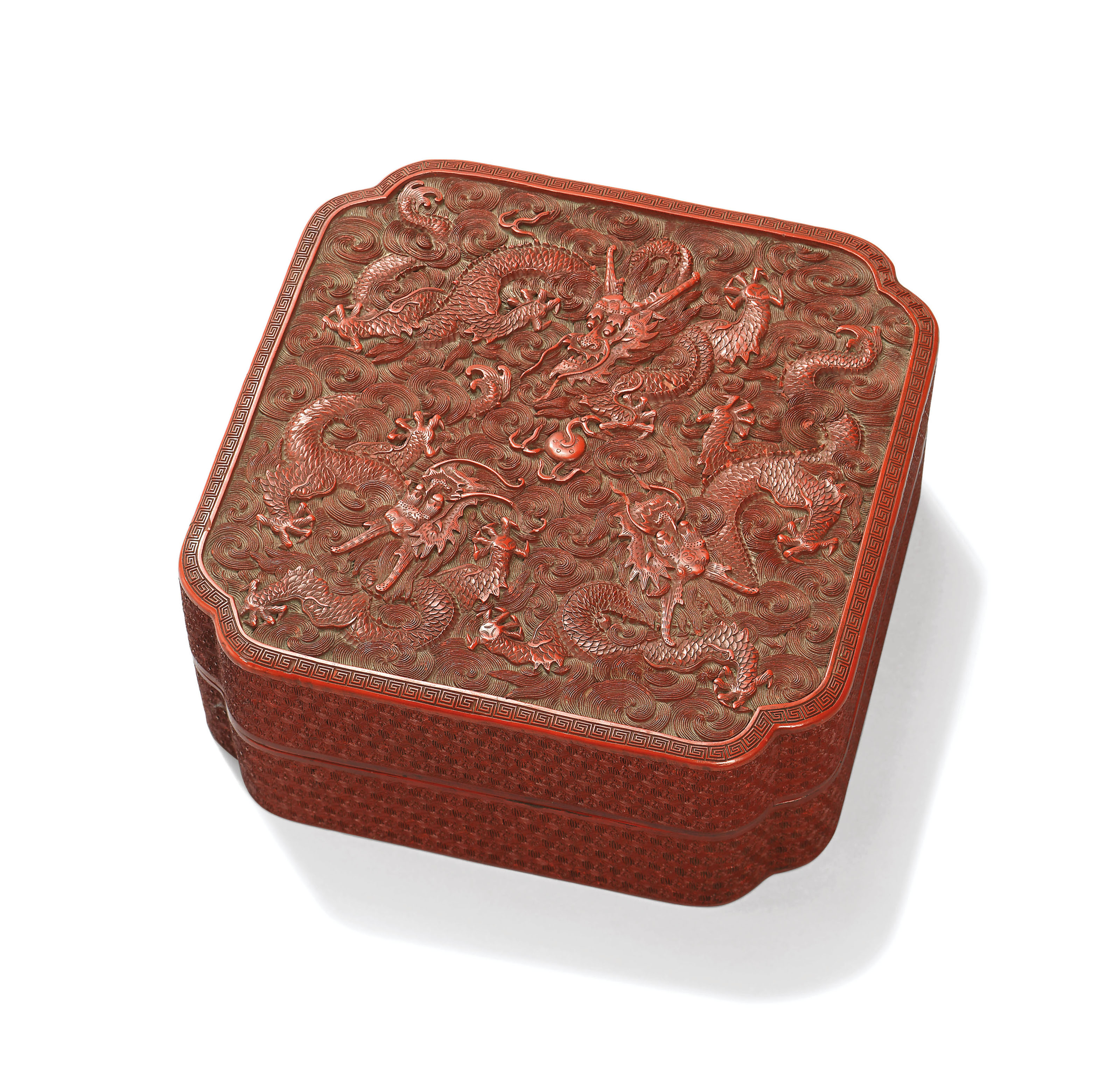 A CARVED CINNABAR LACQUER 'DRAGON' BOX AND COVER