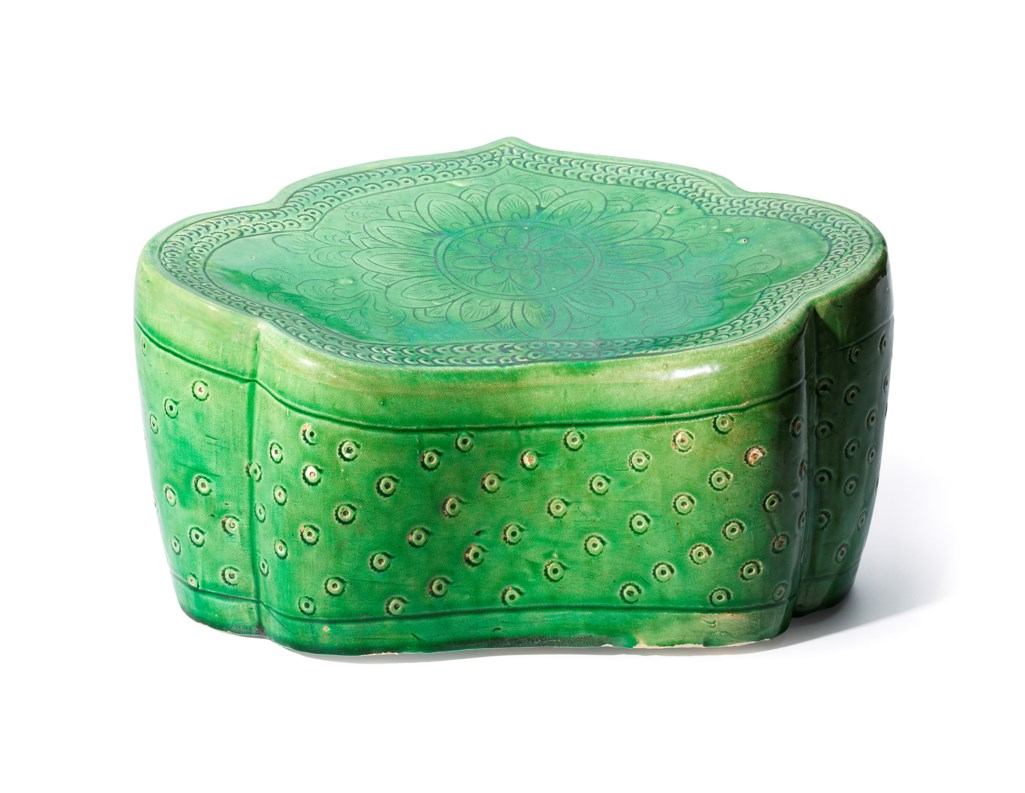 A RARE DING GREEN-GLAZED CARVED 'INDIAN LOTUS' RUYI-SHAPED PILLOW