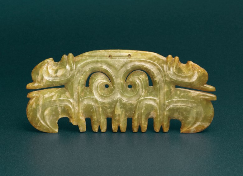 A very rare green jade toothed animal mask ornament, Late Hongshan culture, circa 3500-3000 B.C. 7⅞  in (19.6  cm) wide, box. Sold for HK$10,900,000 on 29 November 2017 at Christie's in Hong Kong