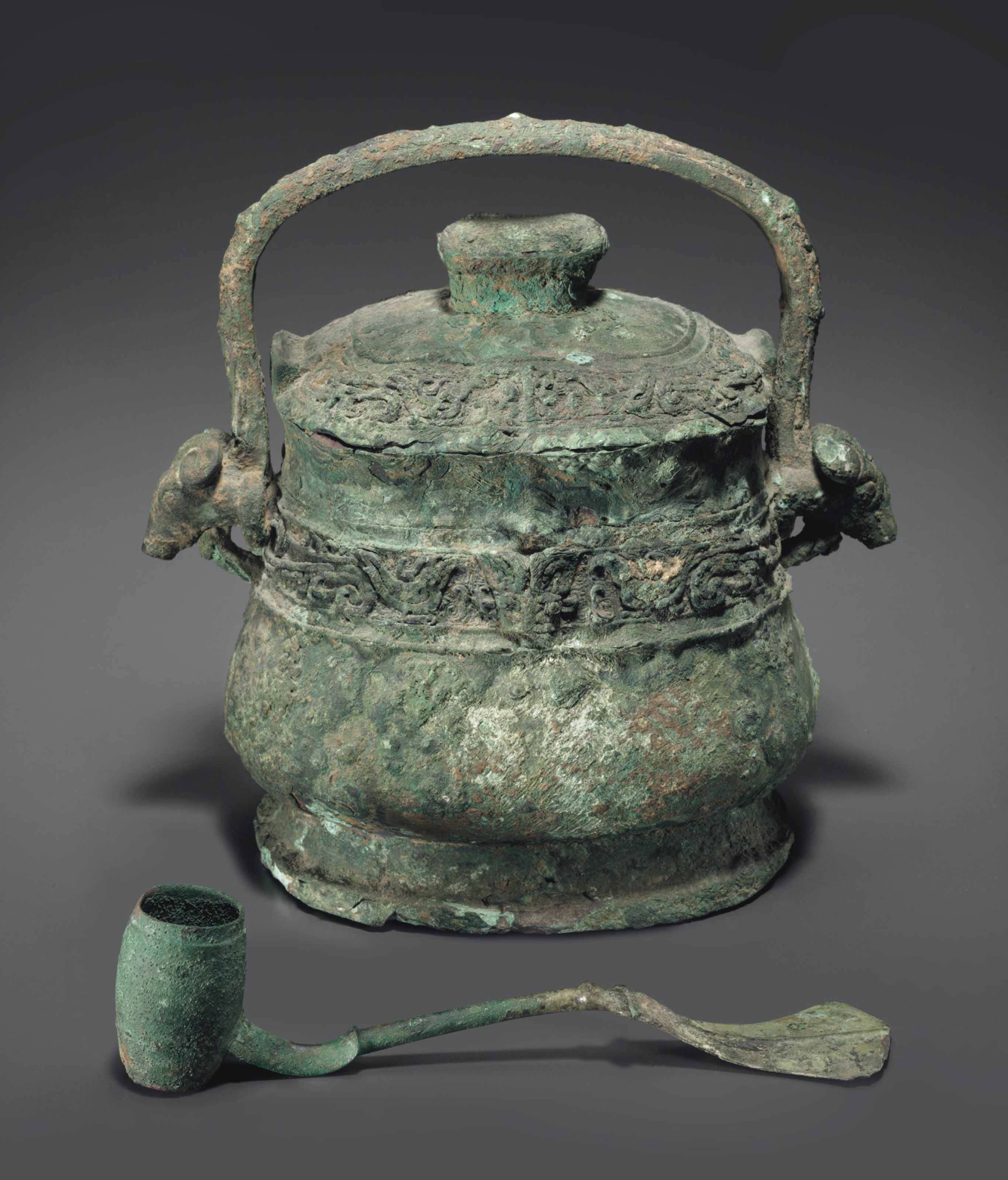A BRONZE RITUAL WINE VESSEL AND COVER, YOU, AND A BRONZE RIT...