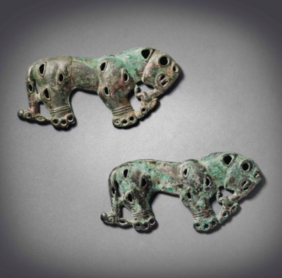 A PAIR OF BRONZE TIGER-SHAPED